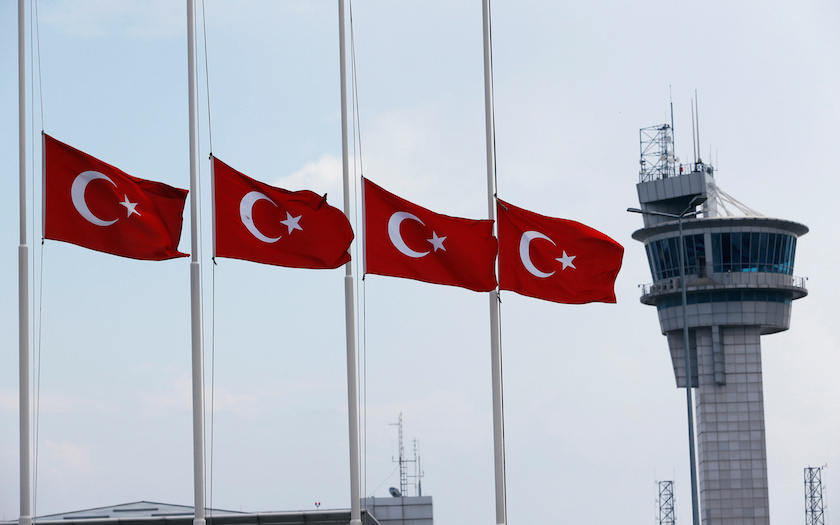 Turkish flags, with the control tower in the background, fly at half mast at the country's largest airport, Istanbul Ataturk, following yesterday's blast in Istanbul