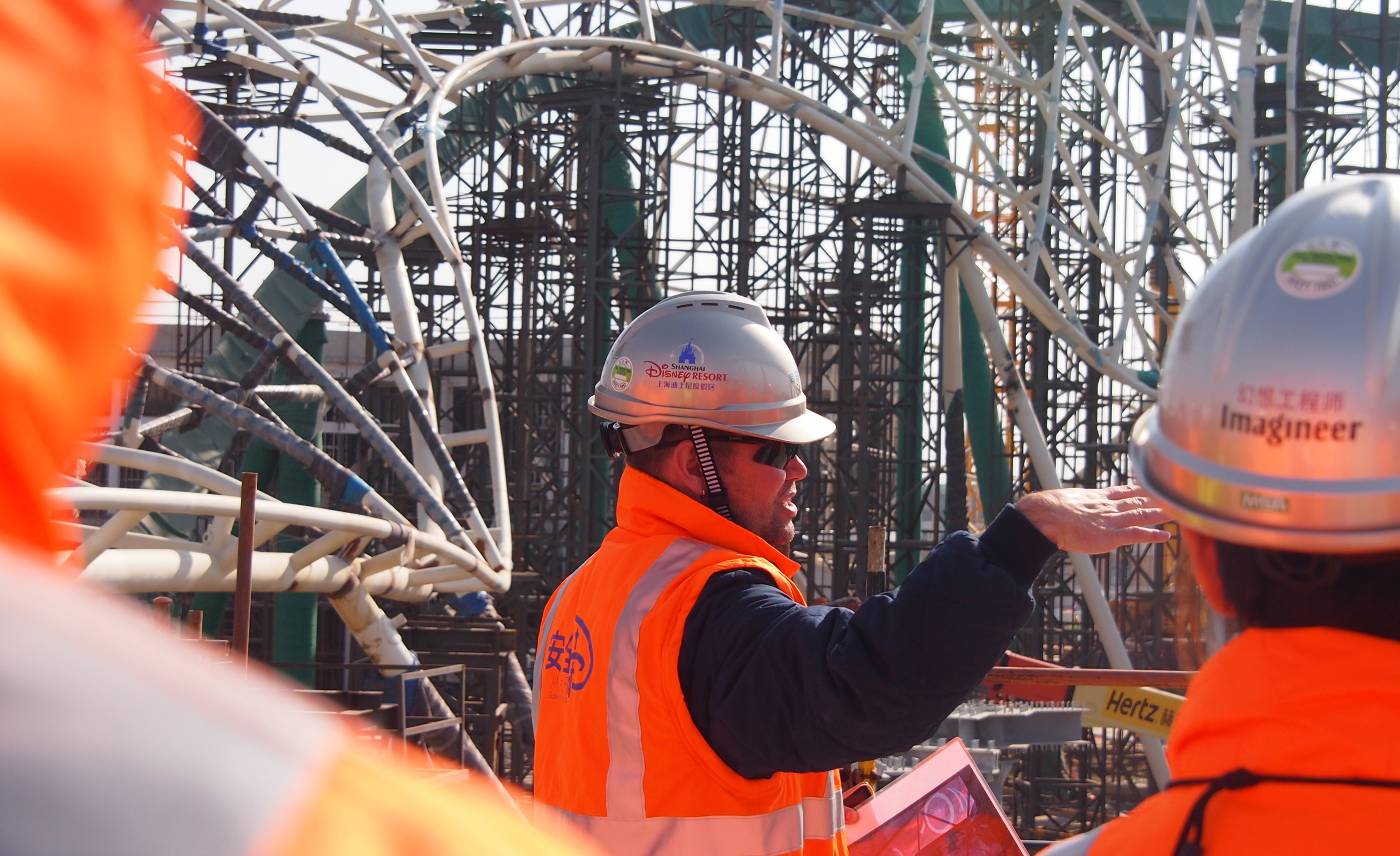 Drake leads one his many site walks to review construction progress on Tomorrowland in July 2015.