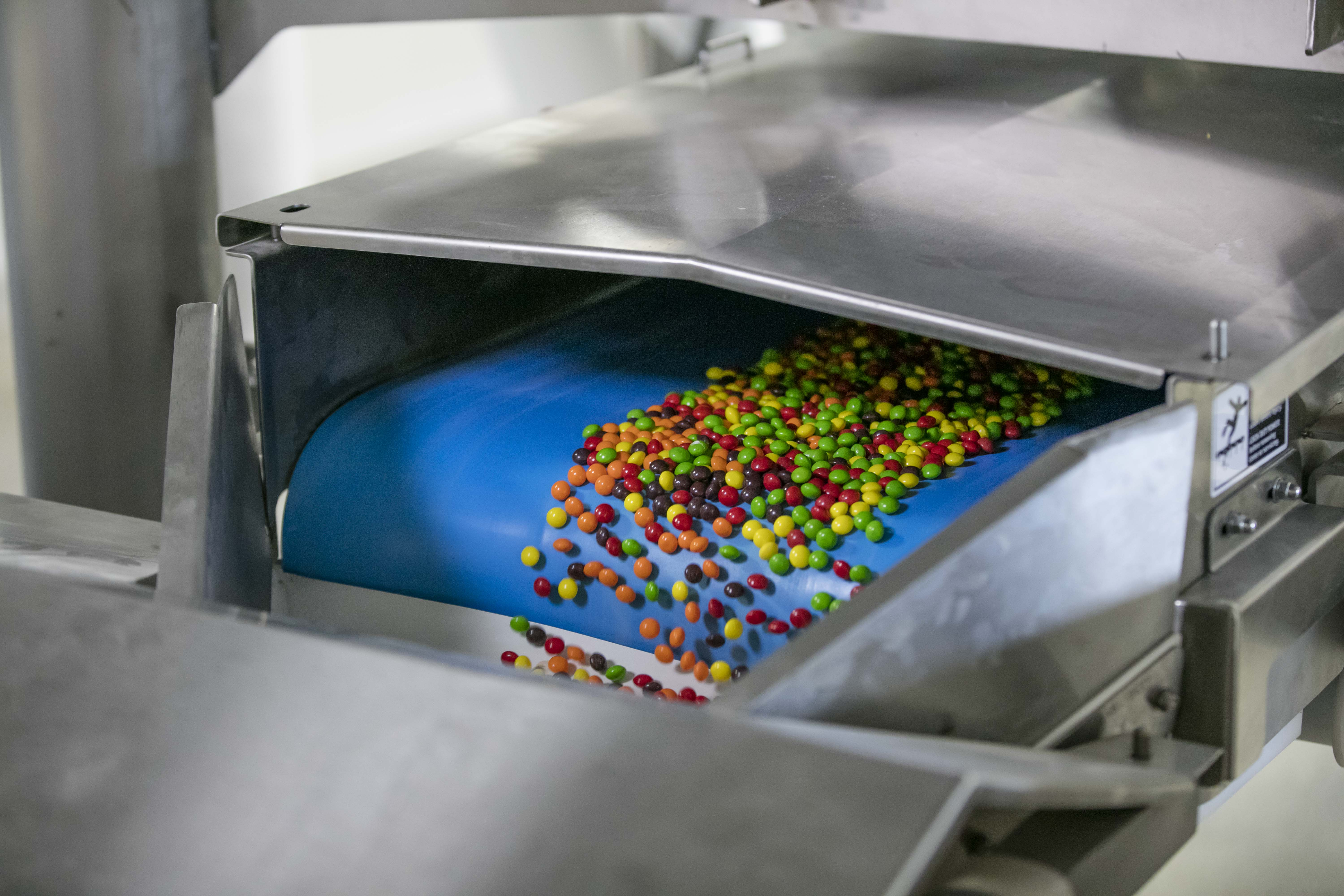 Skittles travel down a mixing belt at Wrigley's Yorkville, Ill., factory.
