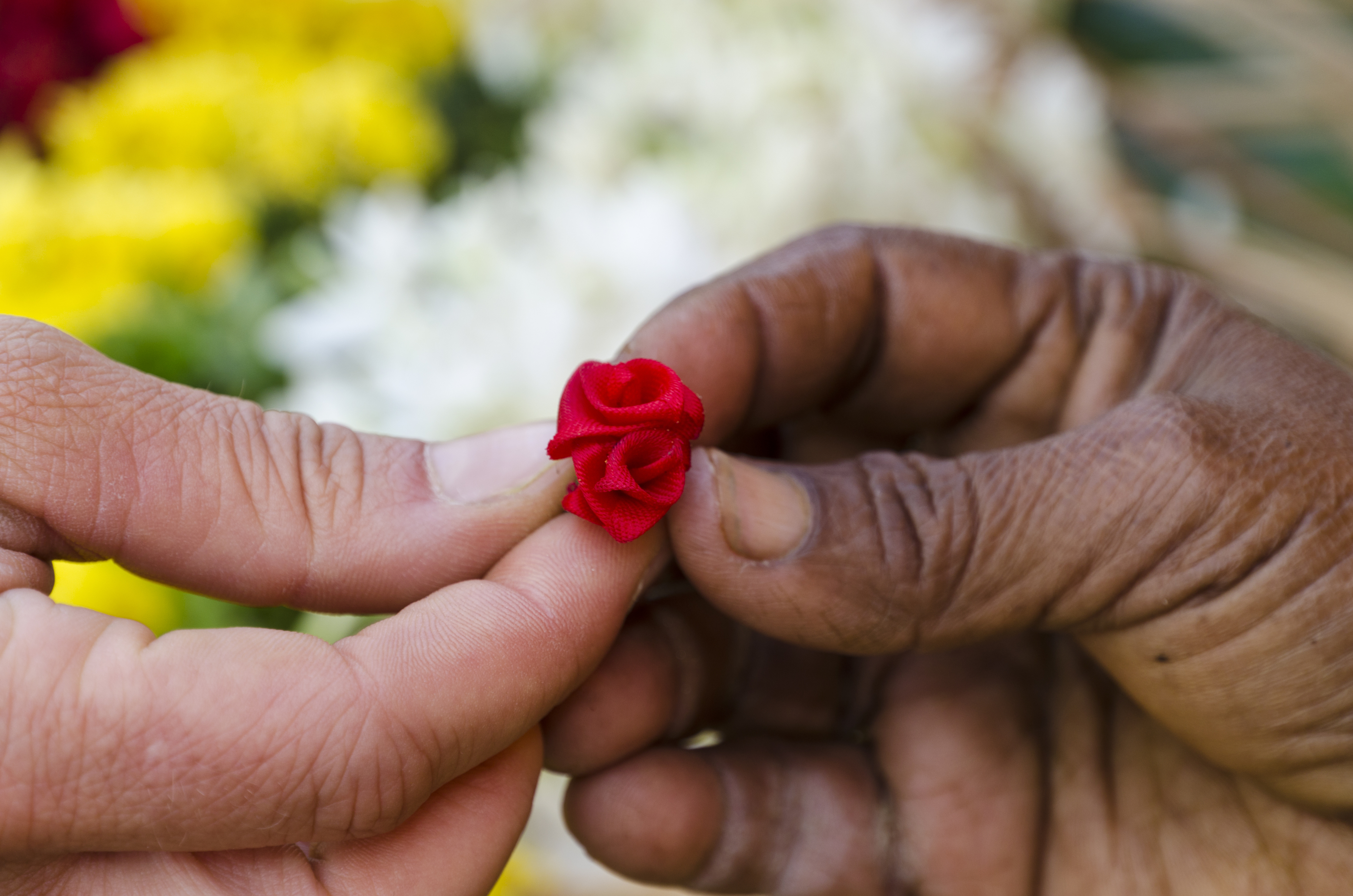 Little artificial flower given to a tourist for gift as a