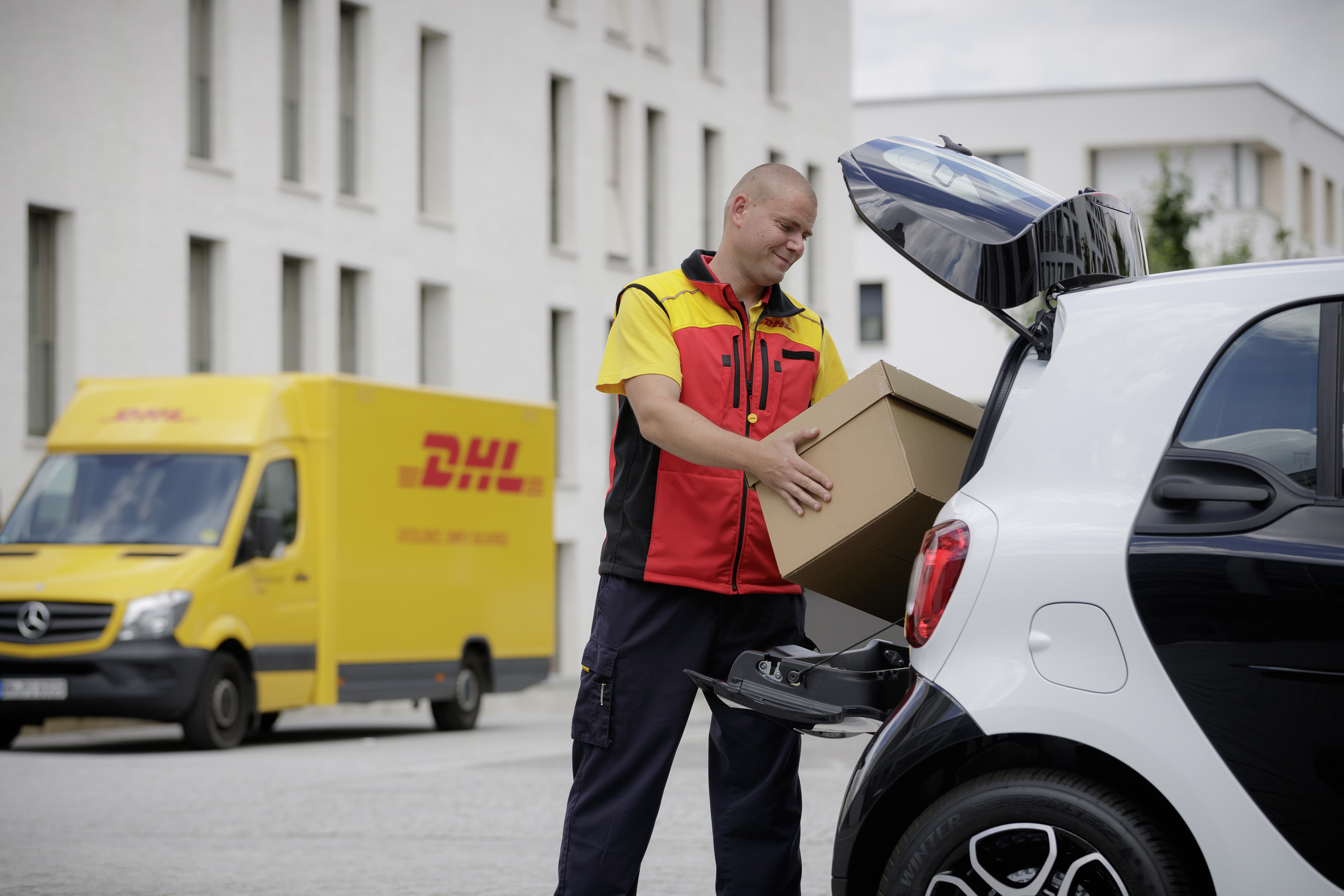 Daimler's Smart cars will be able to take deliveries from DHL.