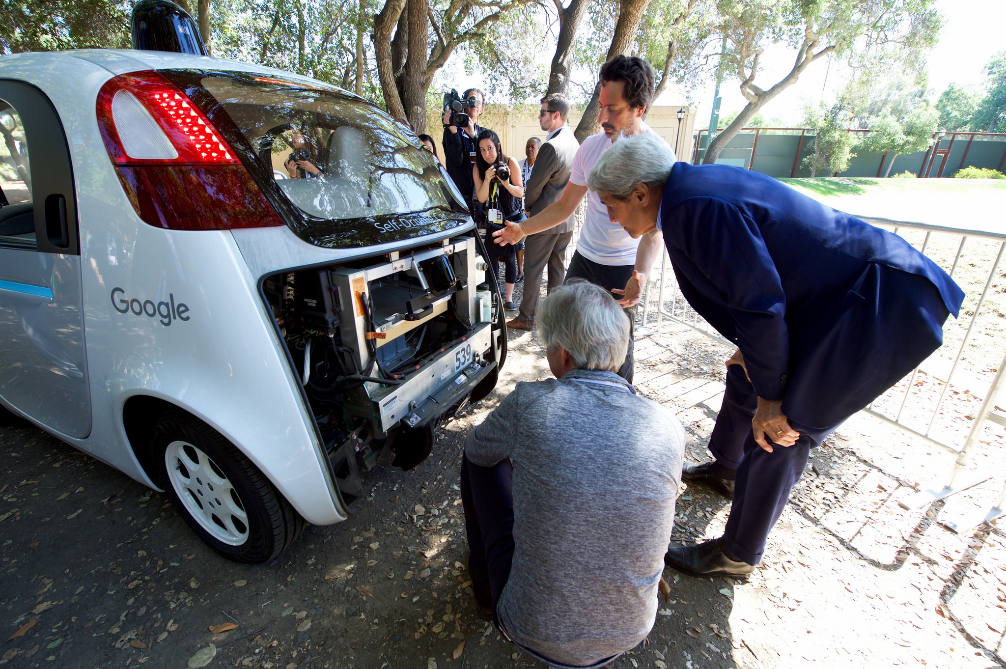 Google co-founder Sergey Brin show U.S. Secretary of State John Kerry the computers inside one of Google's self-driving cars at the 2016 Global Entrepreneurship's Innovation Marketplace on the campus of Stanford University in Palo Alto, California, on June 23, 2016.