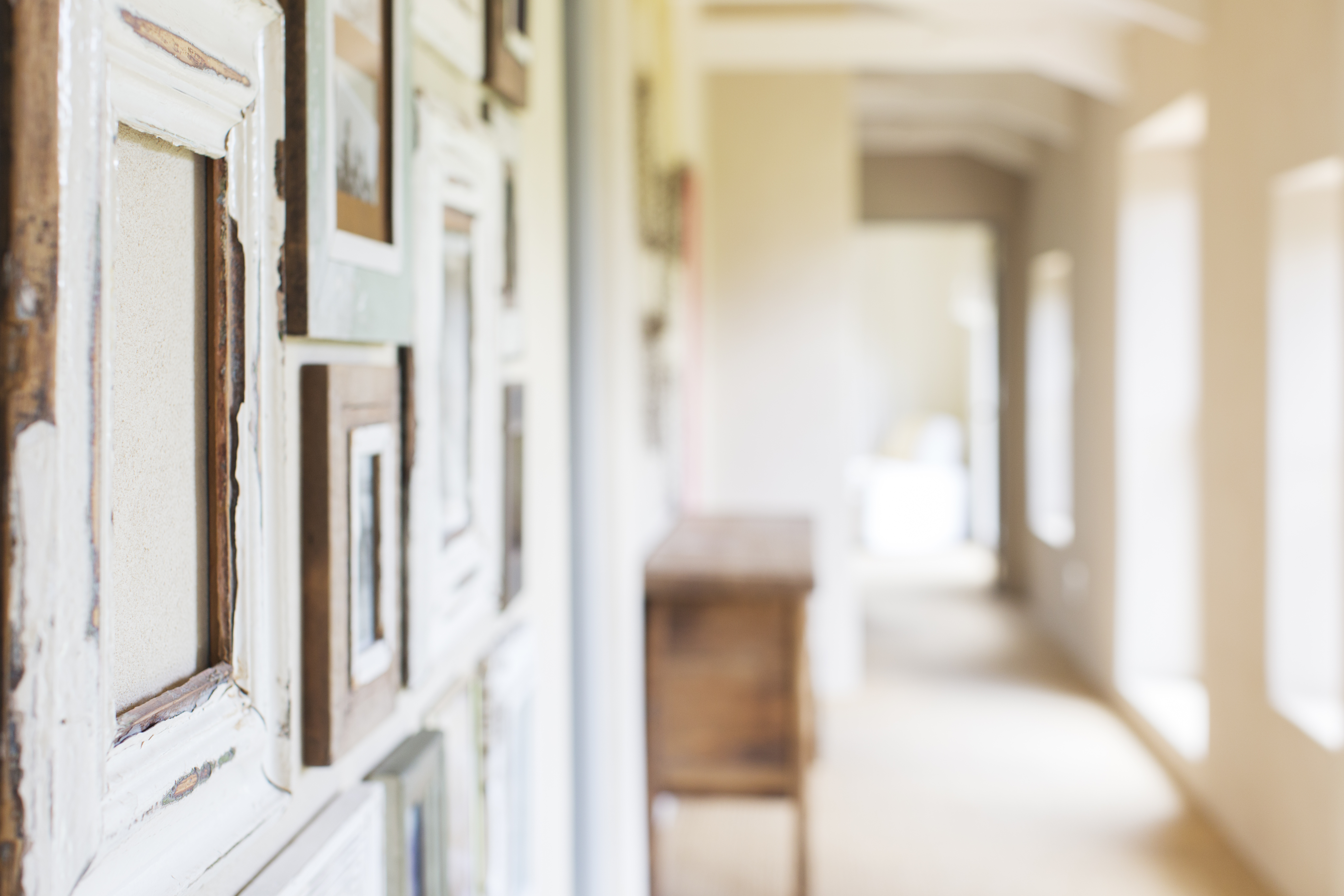 Decorative wall frames in rustic hallway