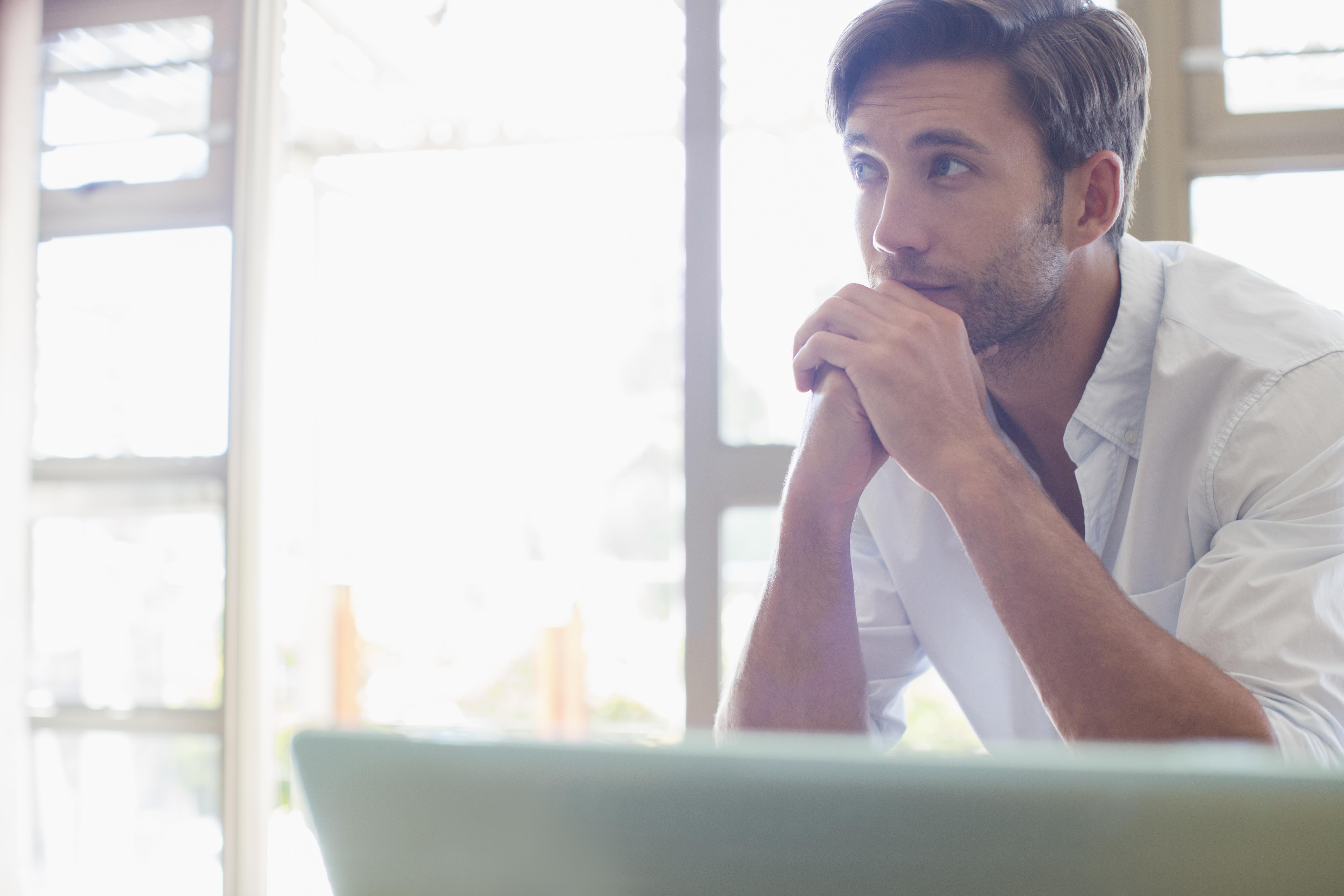 Man sitting at laptop