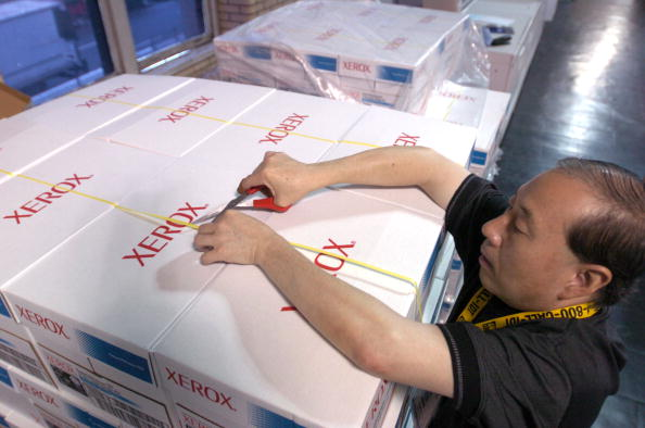 Lap Yeung, an employee for Xerox Corp., opens a palette of p