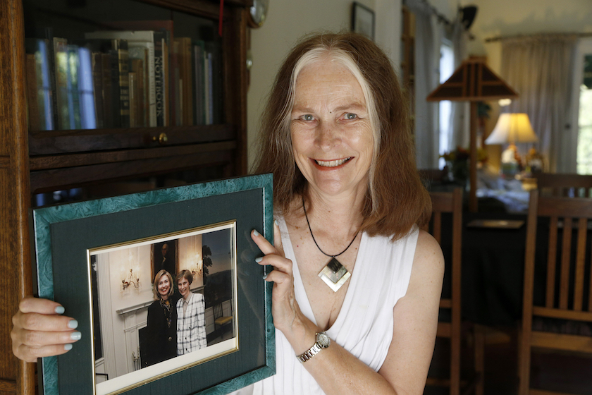 Cheryl Lawson Walker holds a photo of her with Hillary Clinton at her home in Los Angeles
