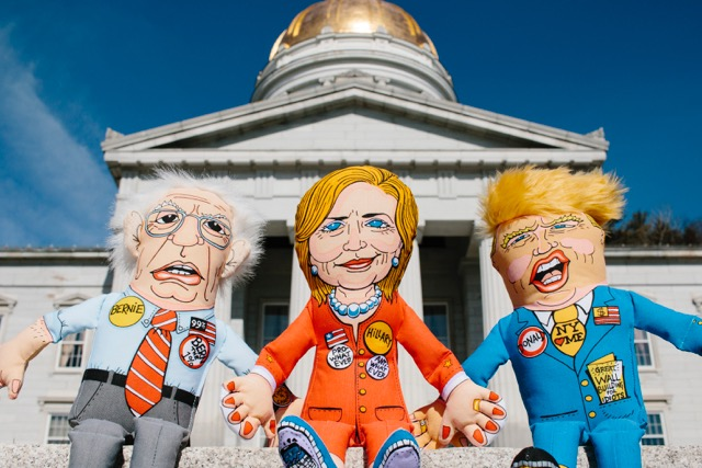 In order from left to right: Bernie Sanders, Hillary Clinton, and Donald Trump as a pet toy.