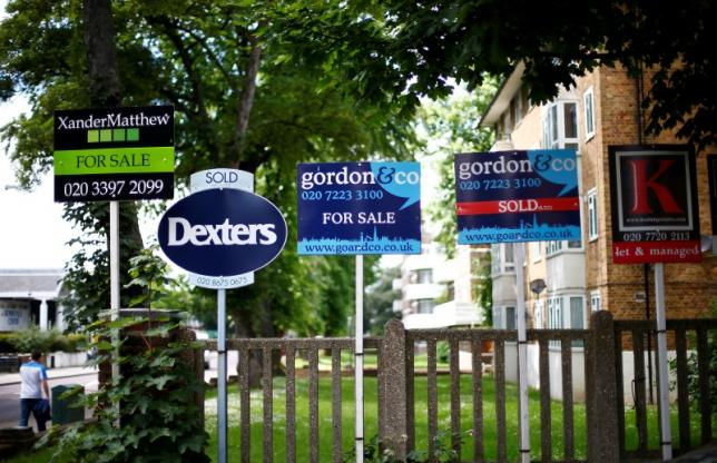 Estate agents boards outside houses in south London