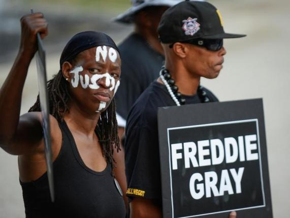 Selah and local artist PFK Boom gather to remember Freddie Gray and all victims of police violence during a rally outside city hall in Baltimore