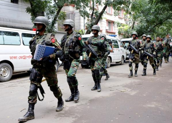 rmy soldiers patrol near the Holey Artisan restaurant after gunmen attacked the upscale cafe, in Dhaka