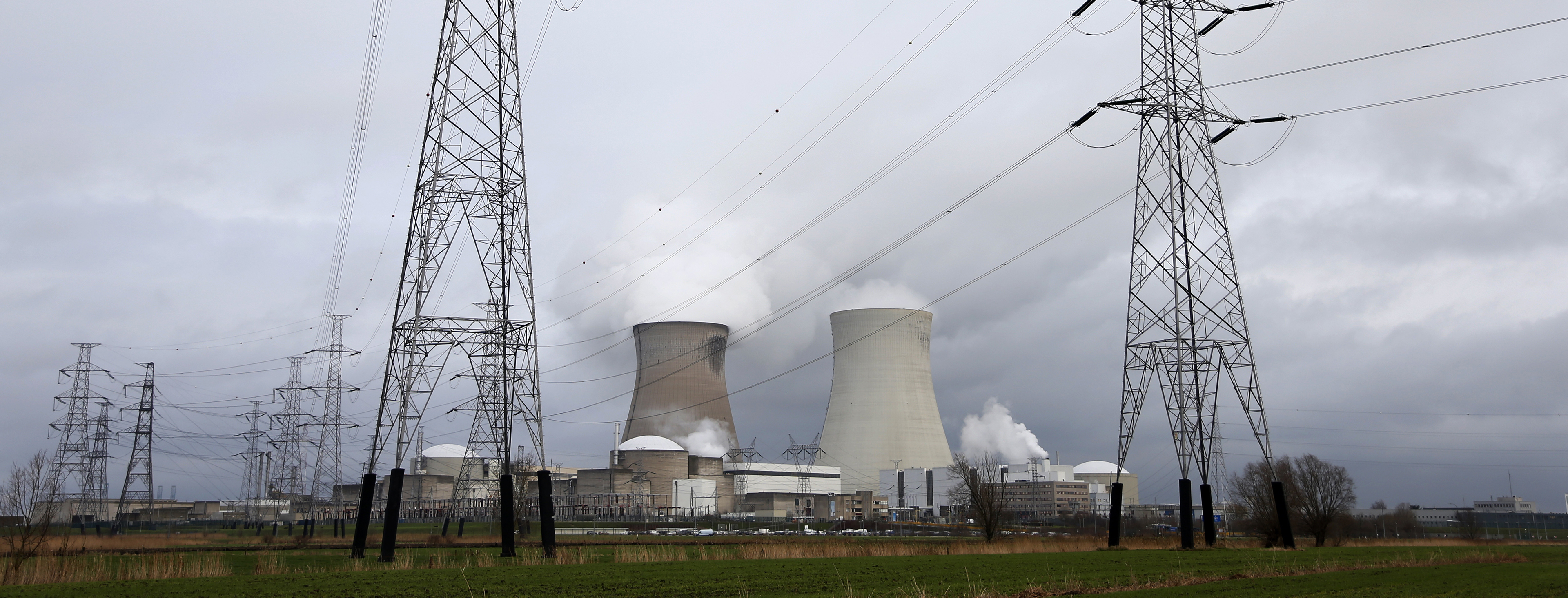 High-voltage power lines are seen next to cooling towers of Doel's nuclear plant of Electrabel in Doel near Antwerp