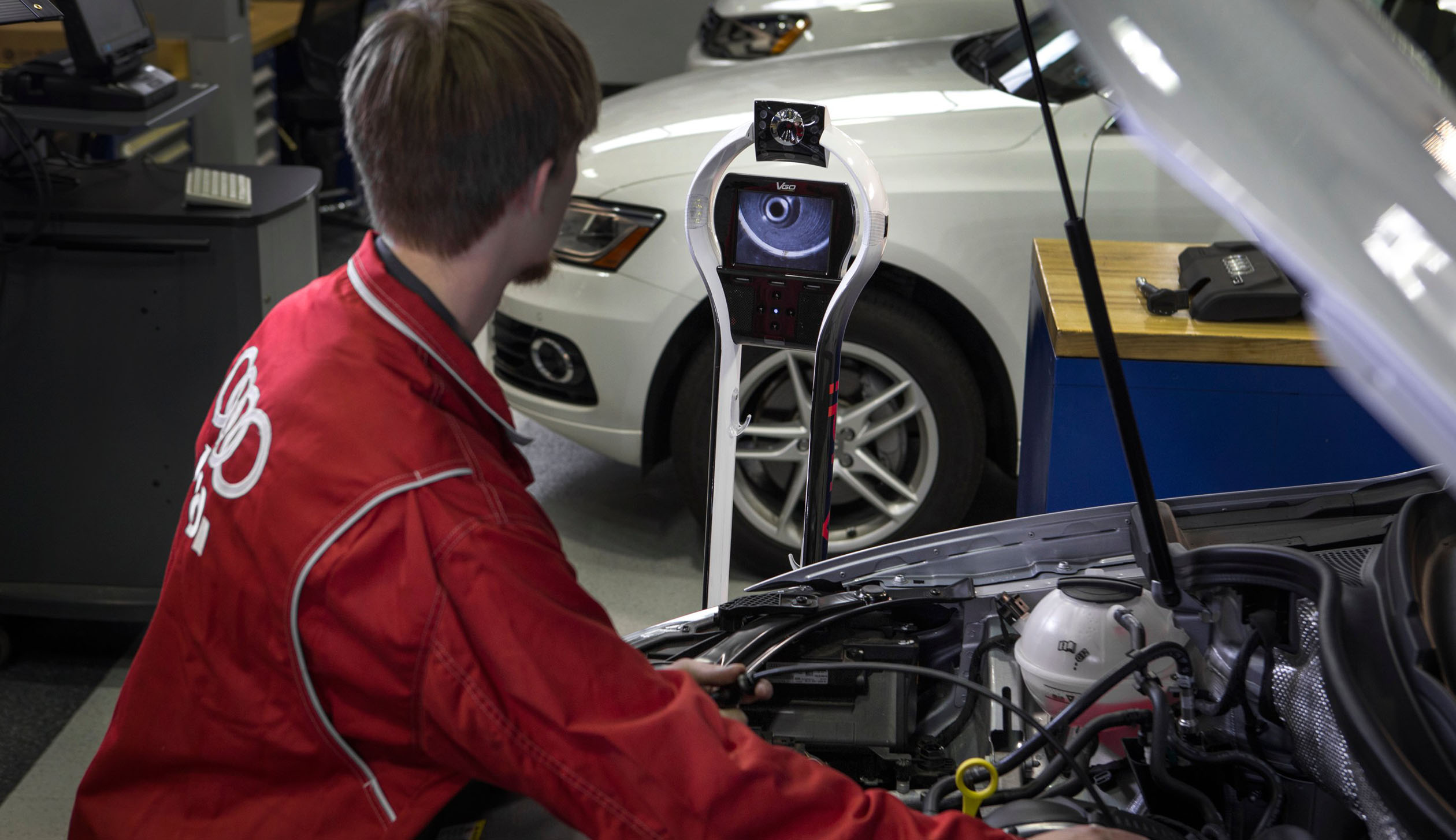 Audi's Remote Telepresence (ART) a remote robot on wheels helps a automotive technician.