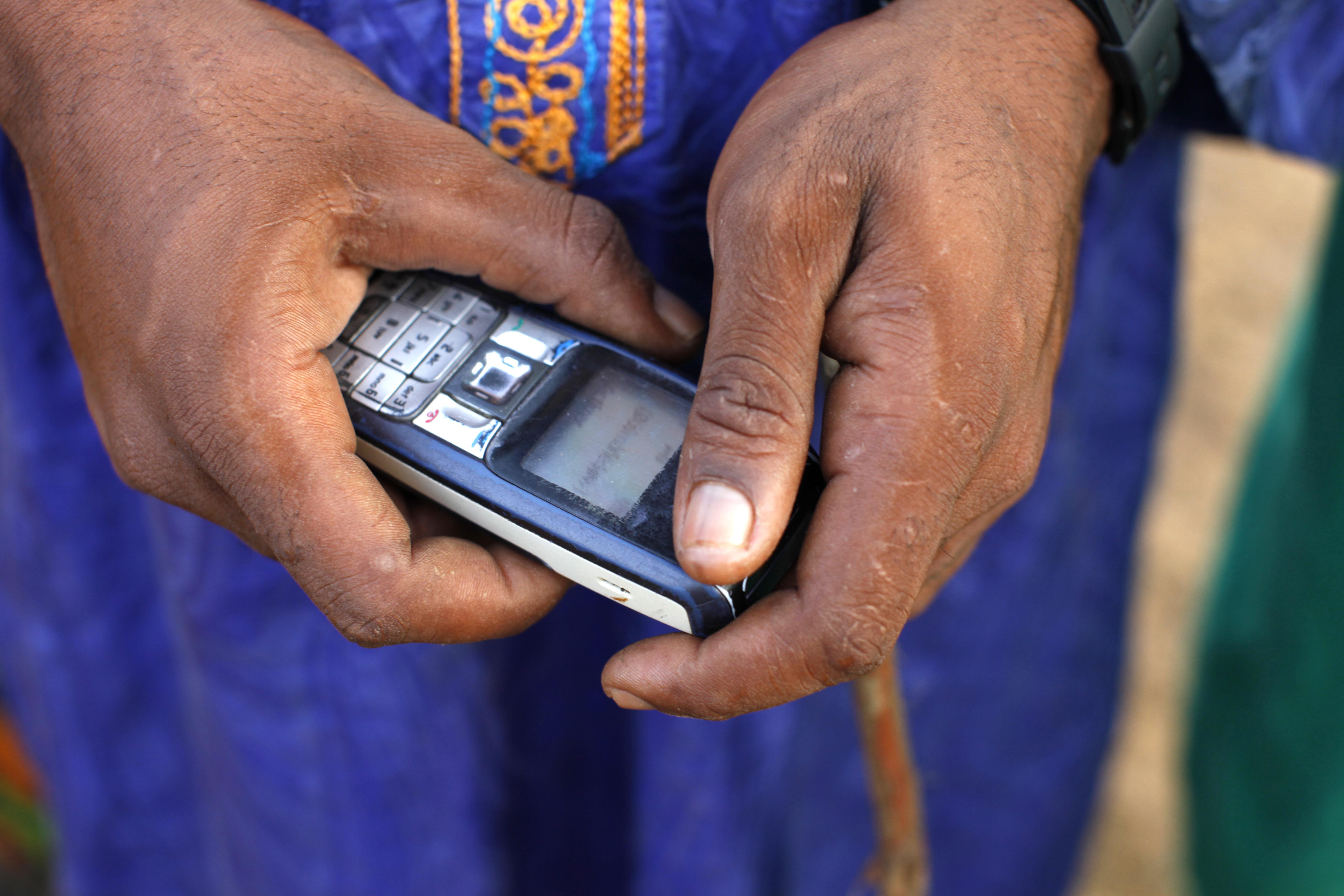 Peul farmer using a cell phone