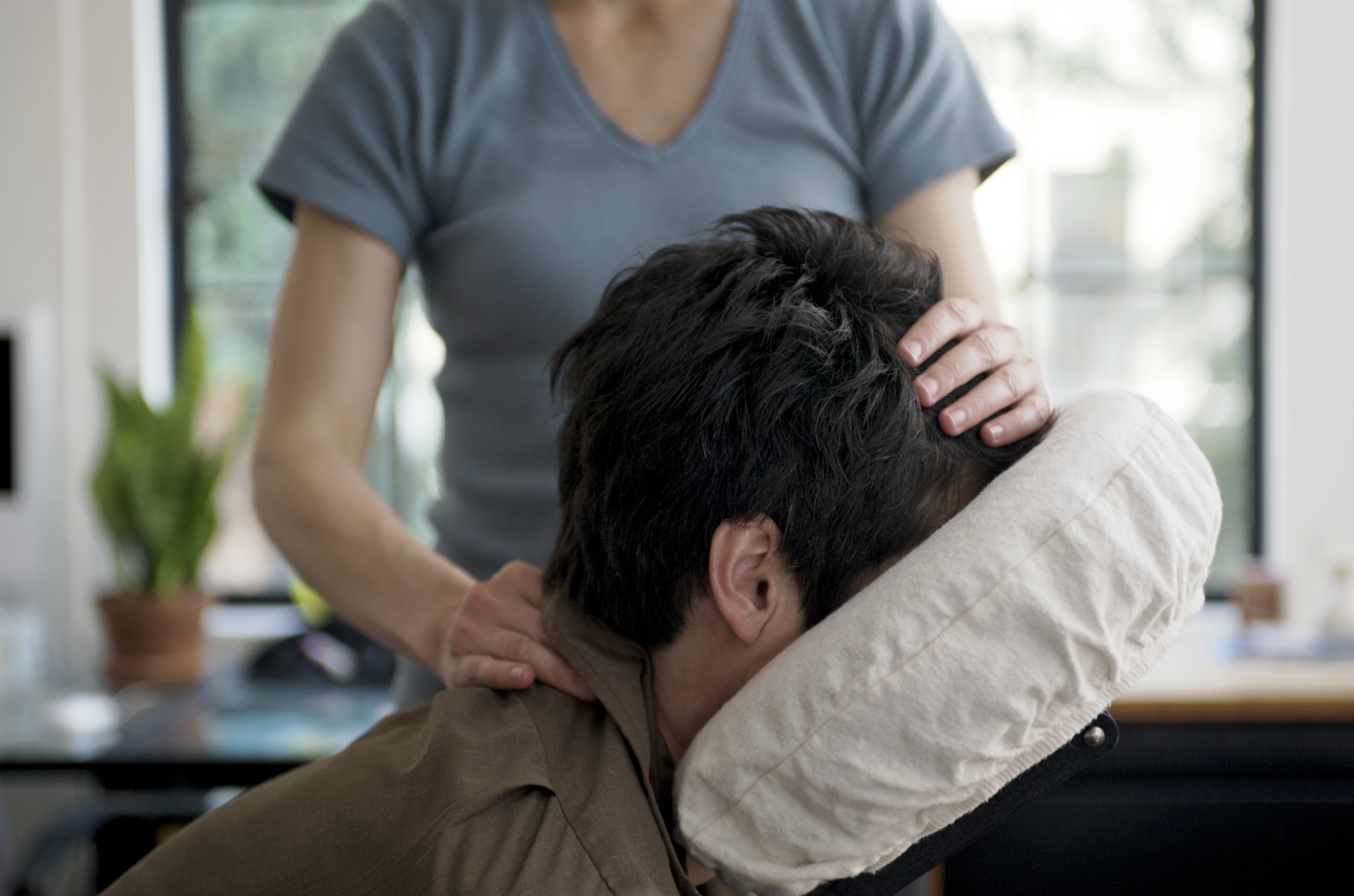 Man Getting Mobile Chair Massage in an Office