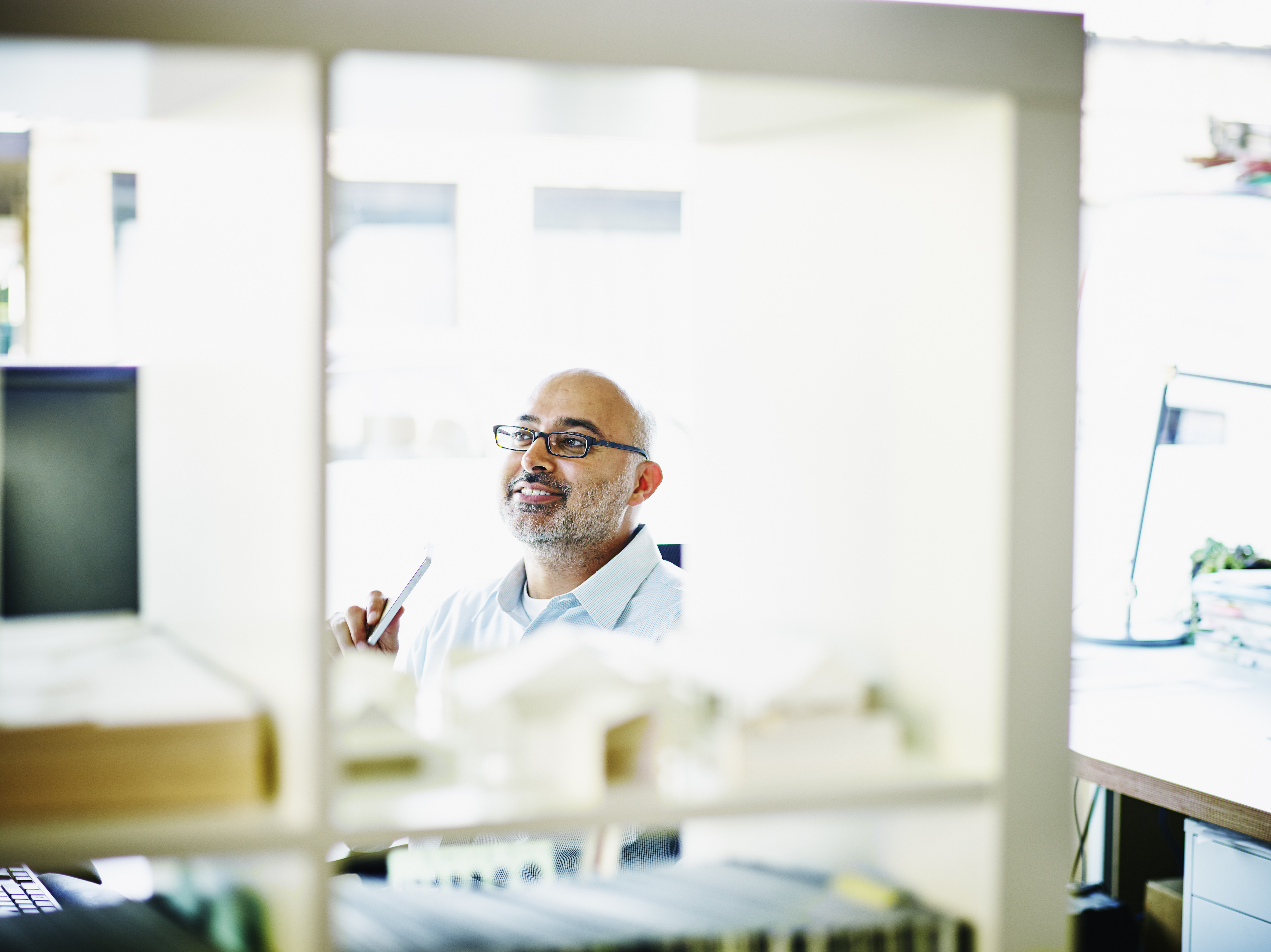 Smiling small business owner sitting in office