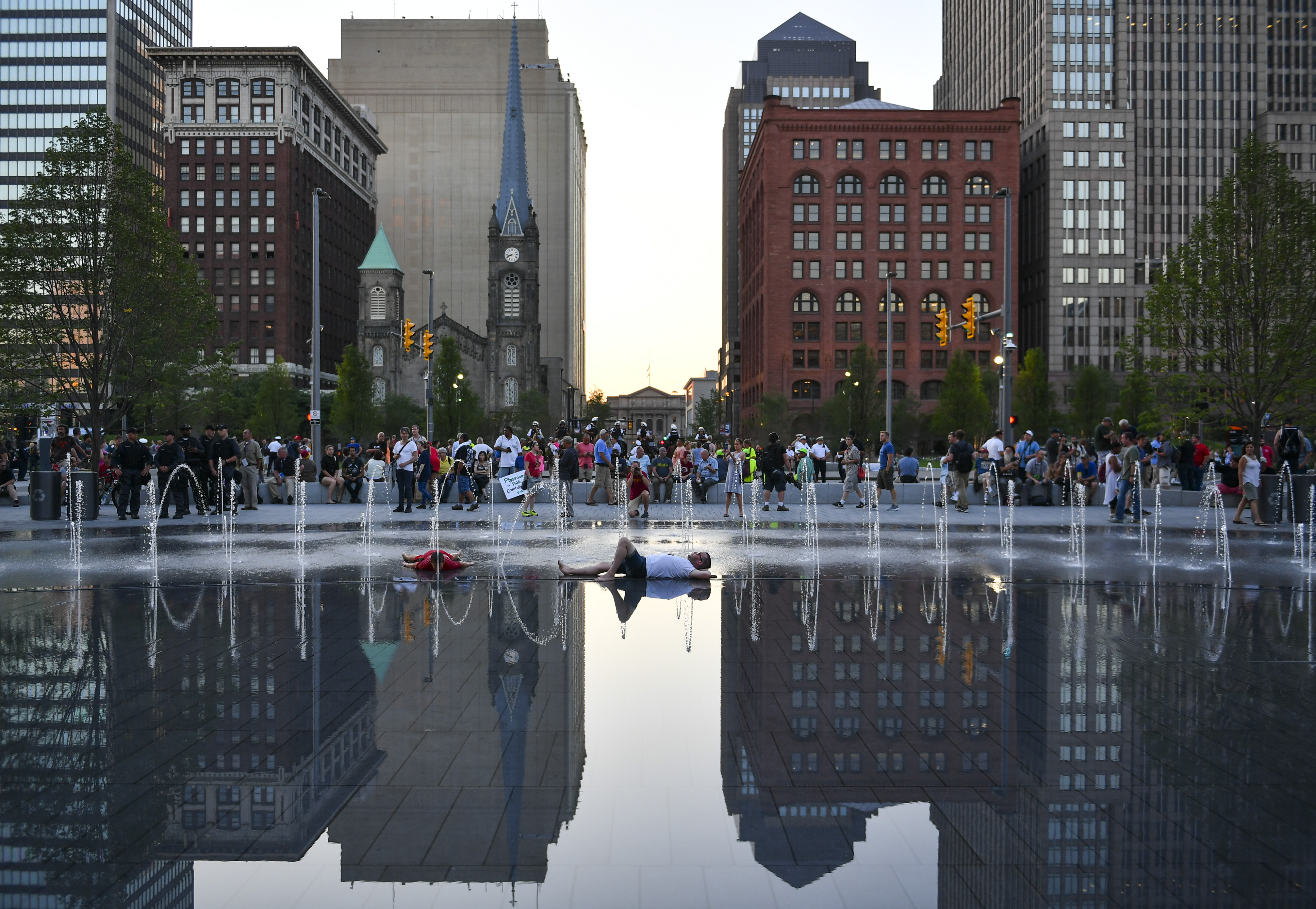 CLEVELAND, OH - JULY 20: A man lies in the fountain at Public S