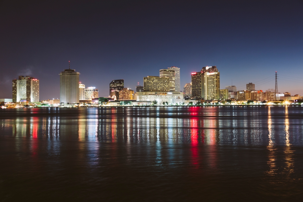 USA, New Orleans, Downtown reflected in the Mississippi river at night