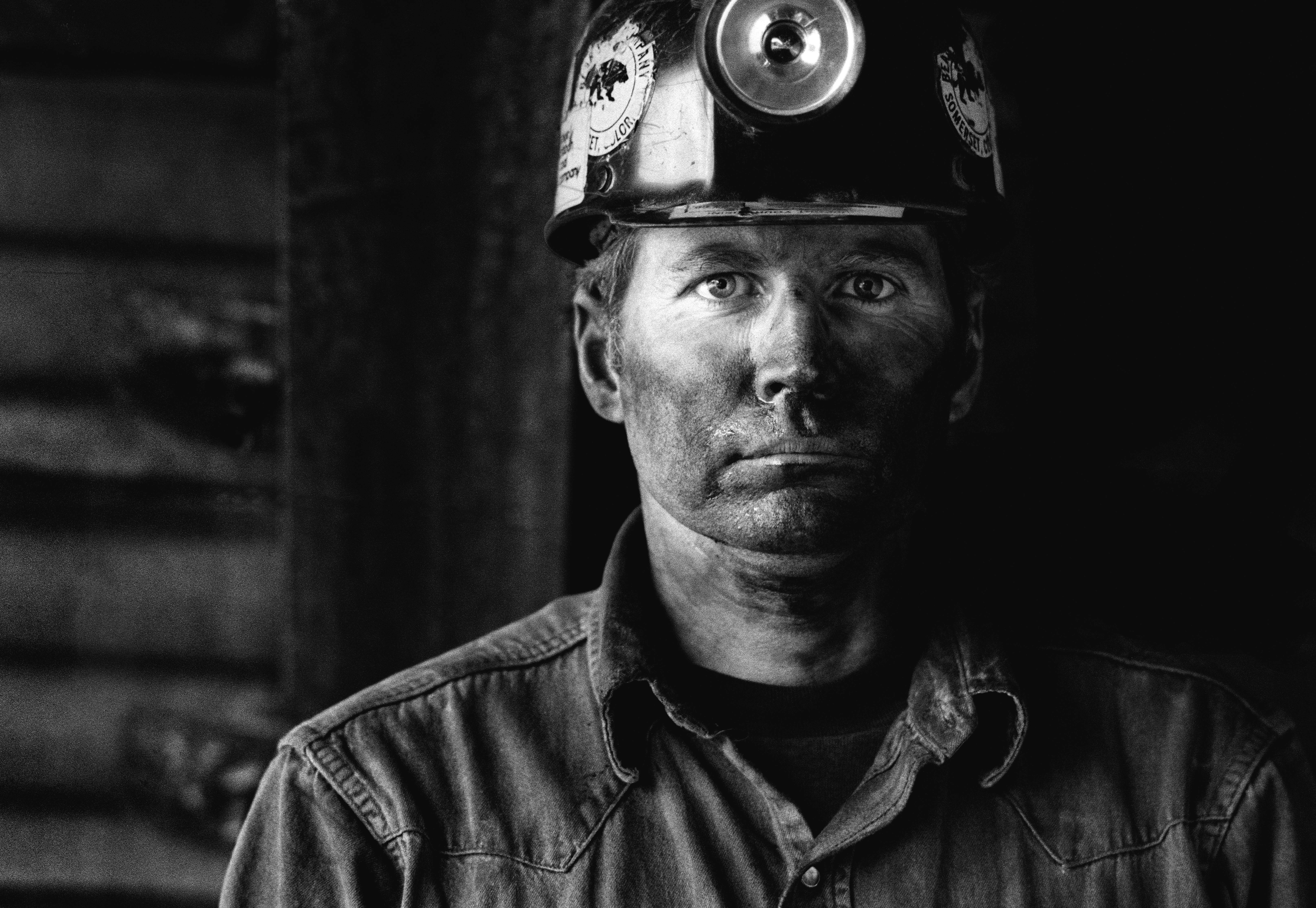 Coal miner covered in coal dust