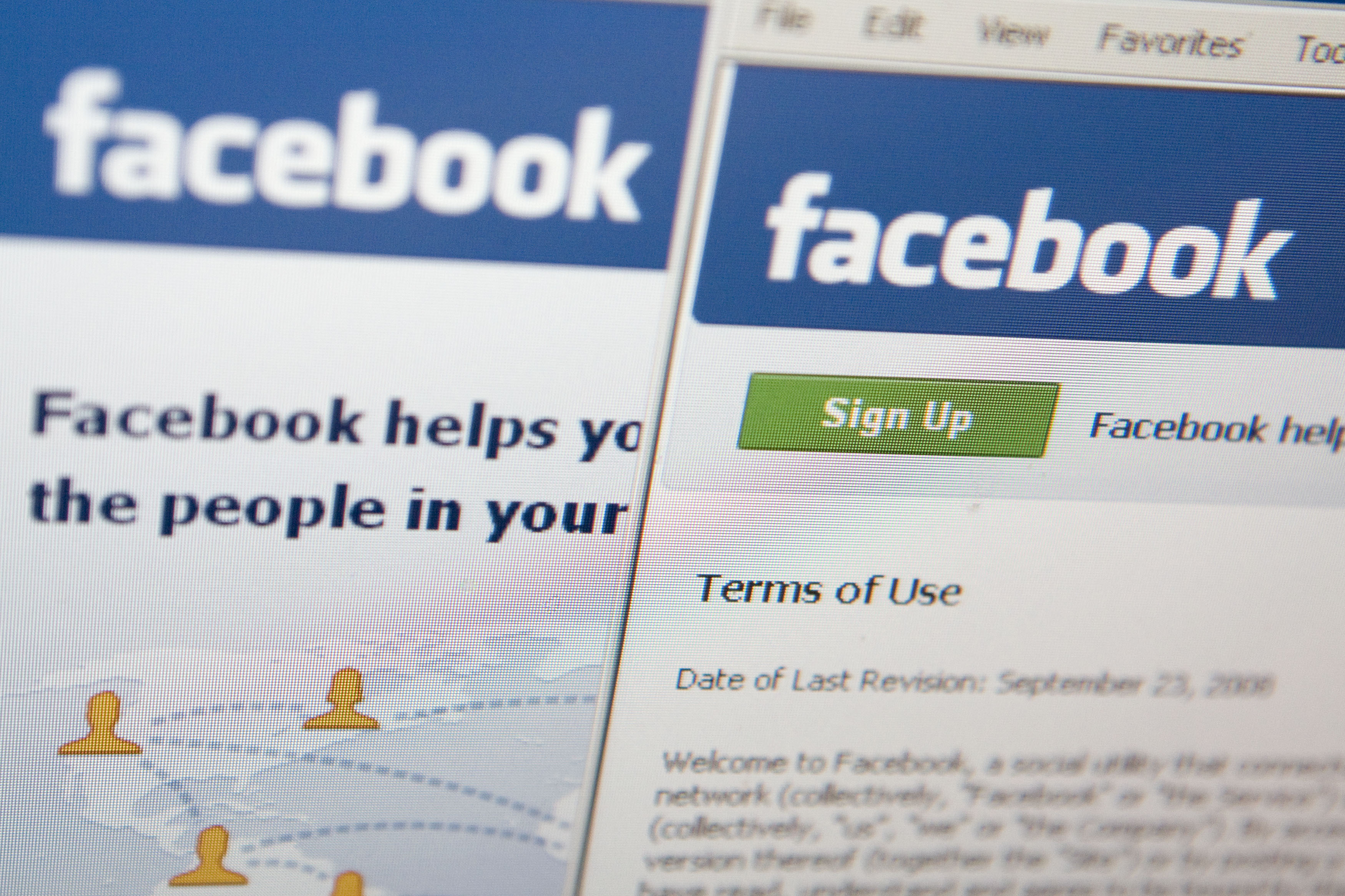 The Facebook terms of use are displayed on a computer monito