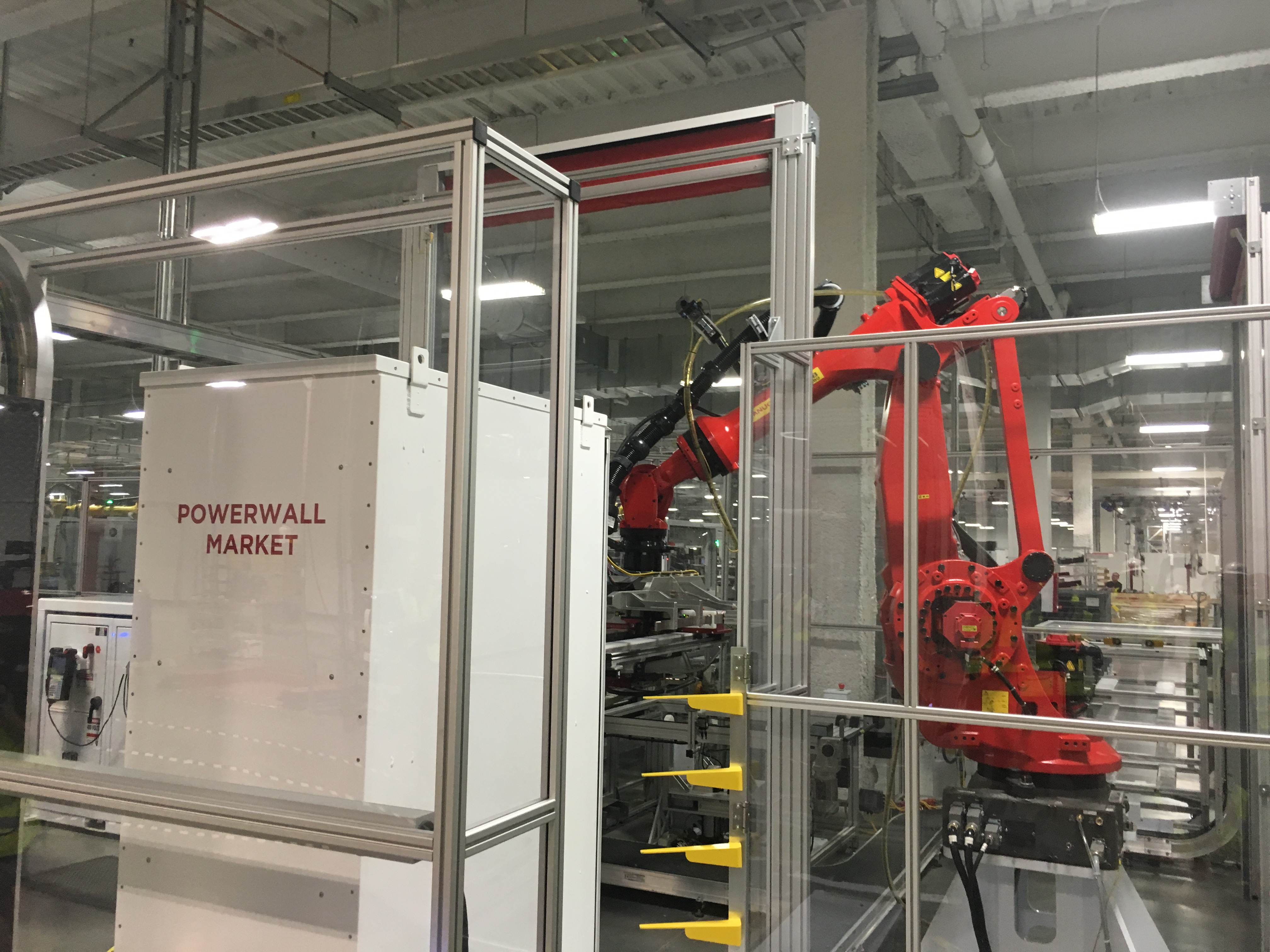 Robots assemble battery packs into Tesla's Powerwall energy storage product.