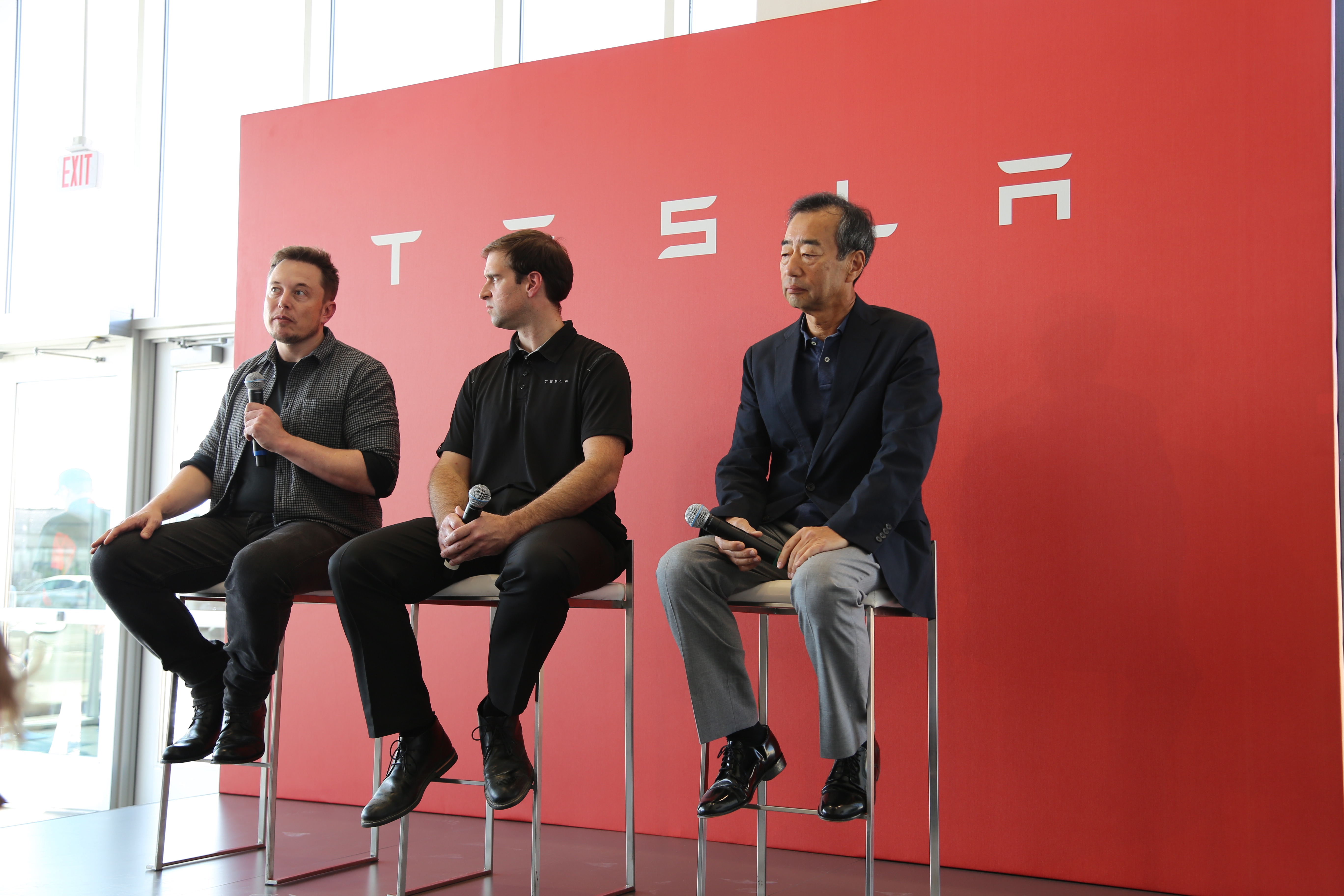 Tesla CEO Elon Musk, CTO JB Straubel, and a Panasonic executive talk about the battery factory.