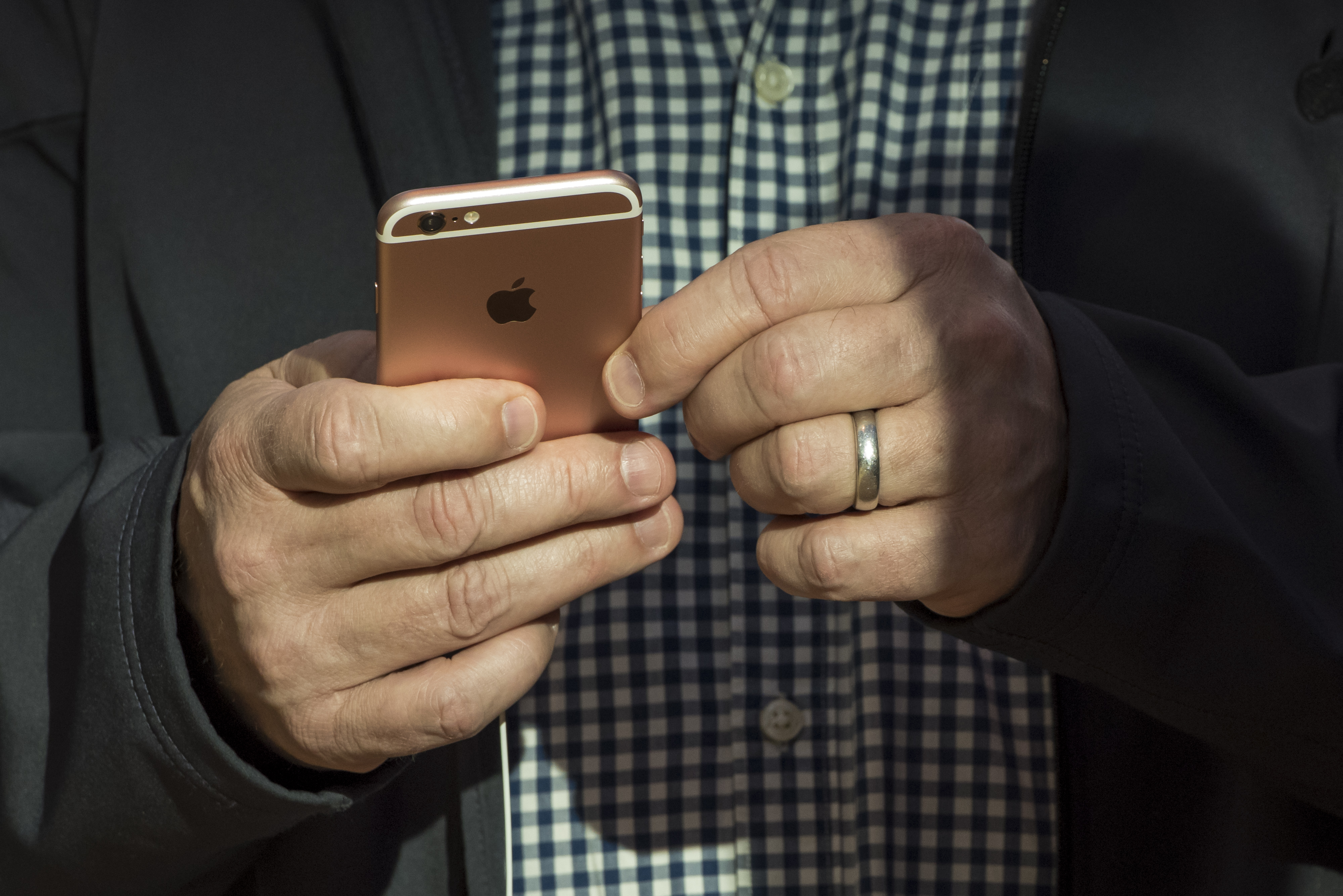 A customer looks at a Apple Inc. iPhone 6s at an Apple store in Palo Alto, California, U.S., on Friday, Sept. 25, 2015.