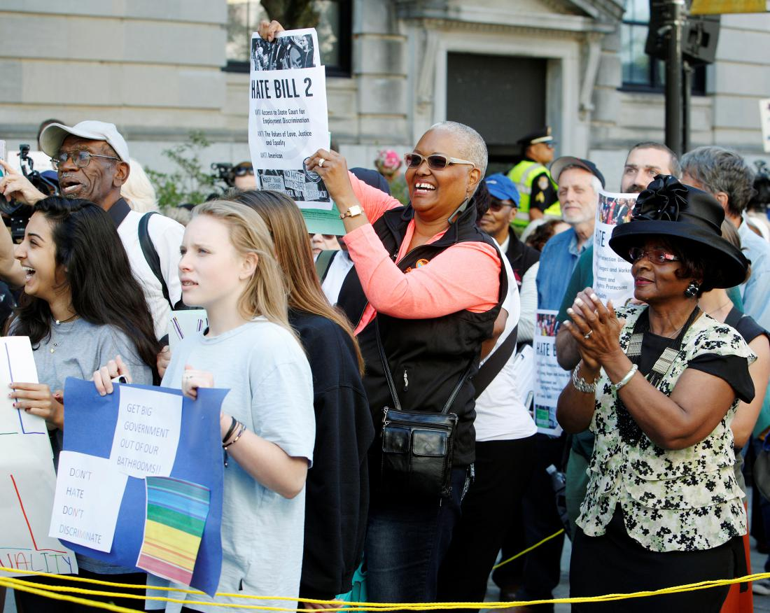 "Members of the black community join a diverse crowd of protesters opposing North Carolina's HB2 ""bathroom law"" during a demonstration outside the state legislature in Raleigh"