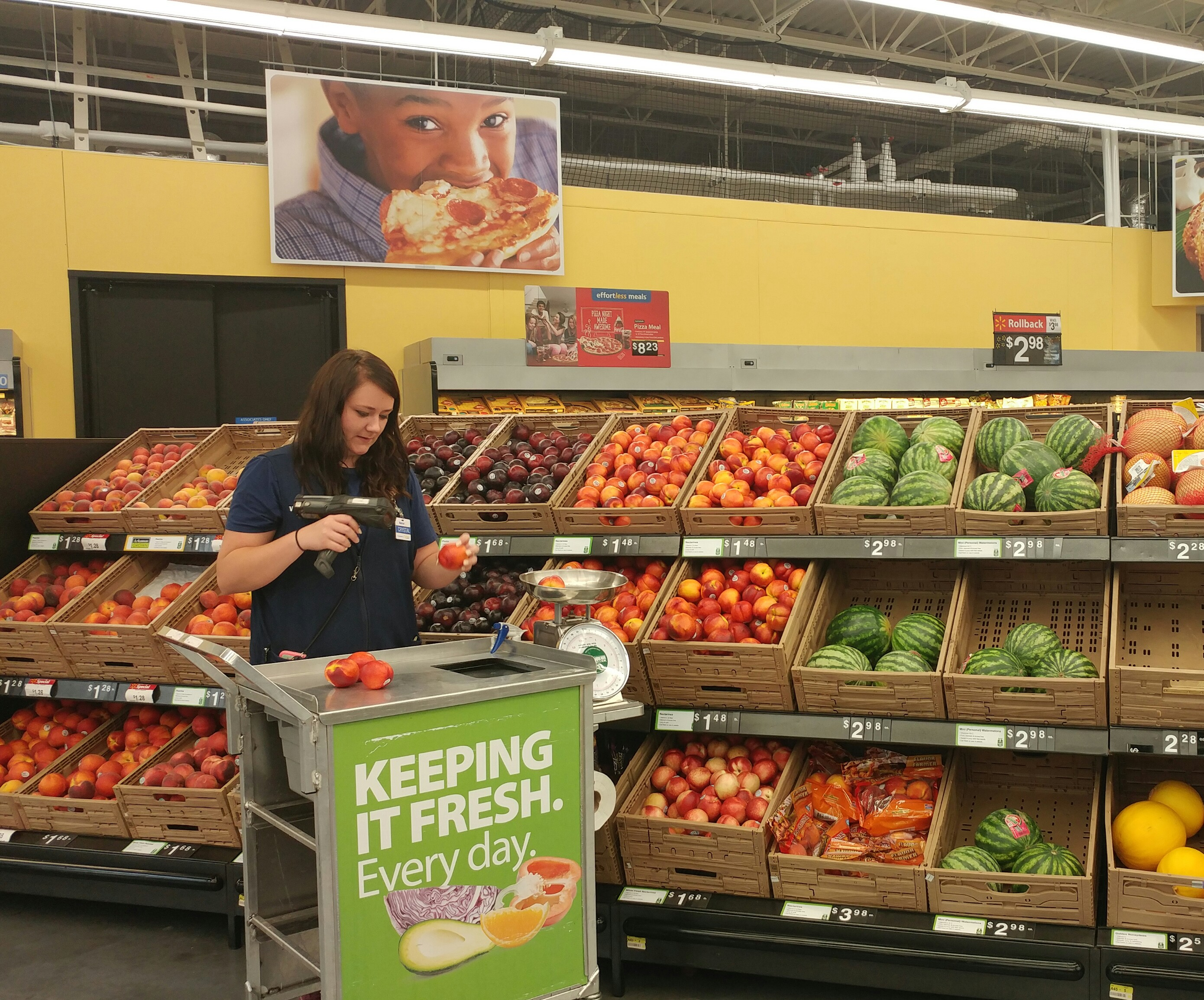 """A Walmart worker using a """"Quality Cart"""" at a store in Springdale, Ark."""
