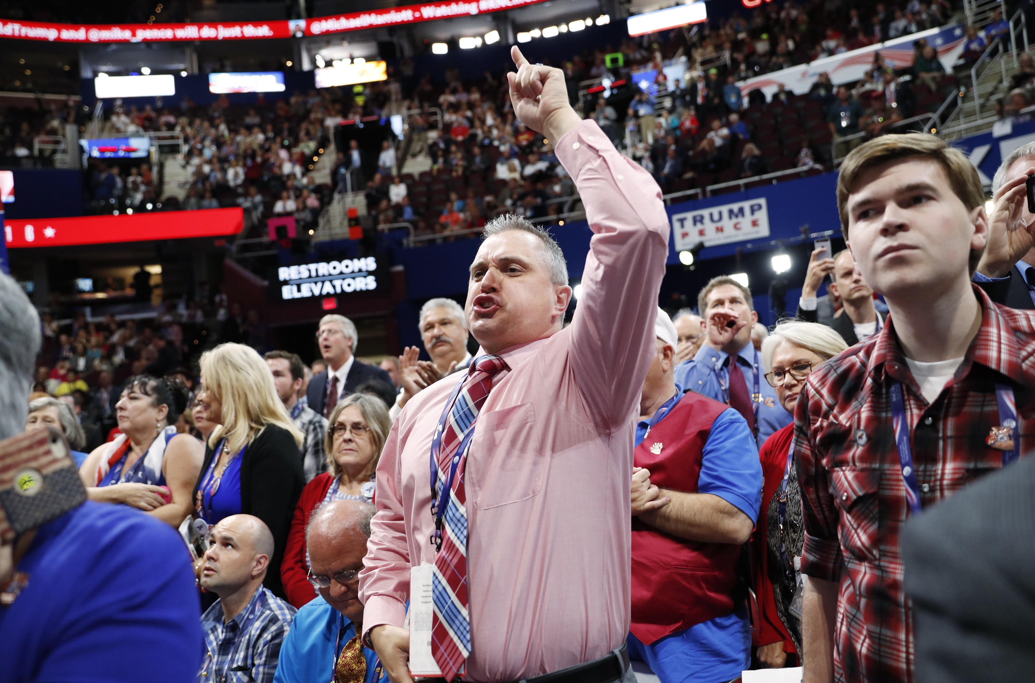 A Republican National Convention delegate screams as the Chair announces that the convention will not hold a roll-call vote at the Republican National Convention in Cleveland
