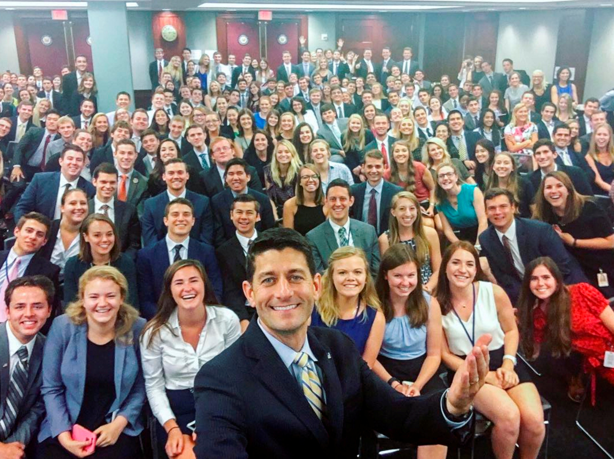 A group of Capitol Hill interns pose for a picture taken by Republican Speaker of the House Paul Ryan
