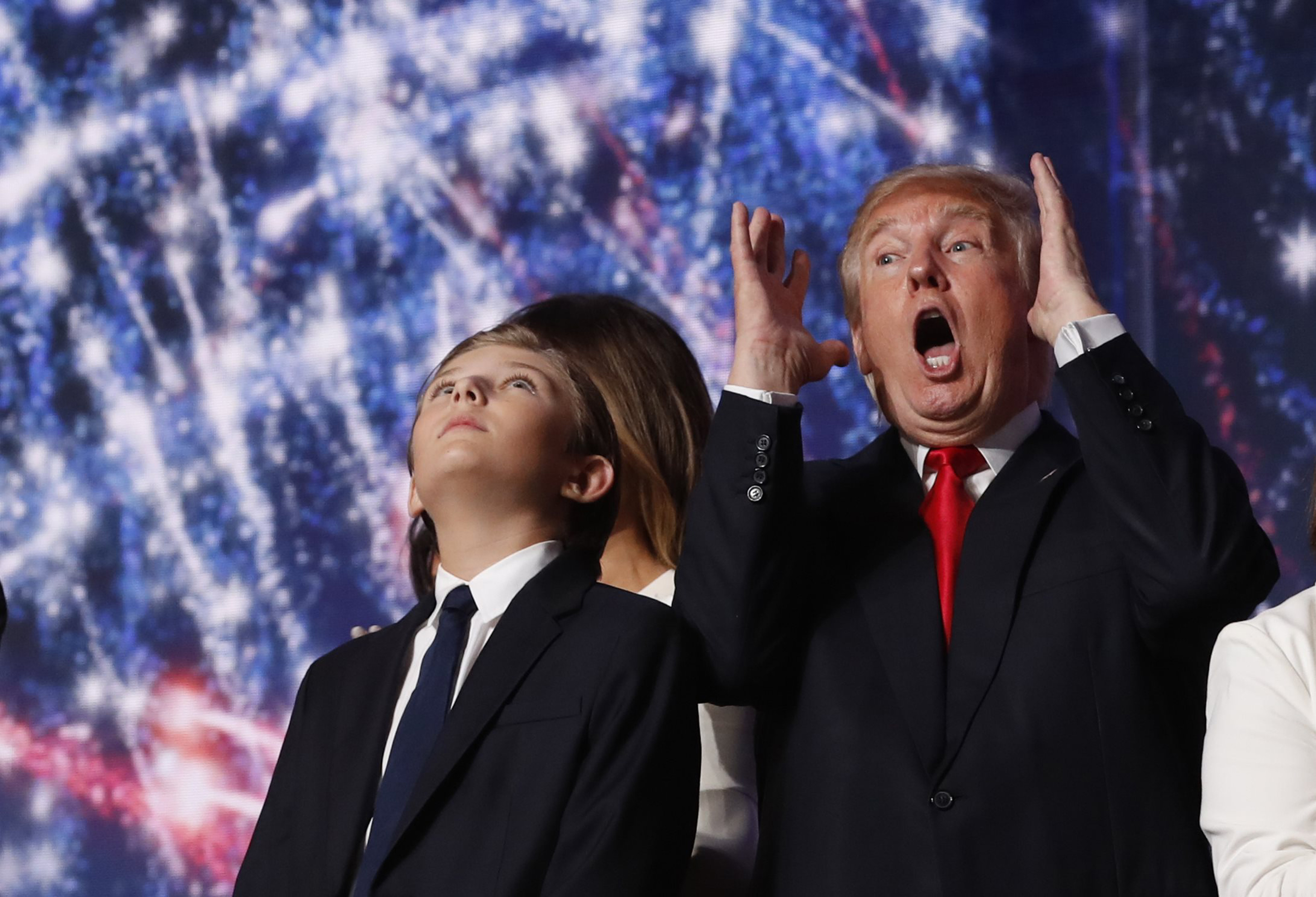 Republican U.S. presidential nominee Trump reacts to balloons, confetti and electronic fireworks at the Republican National Convention in Cleveland