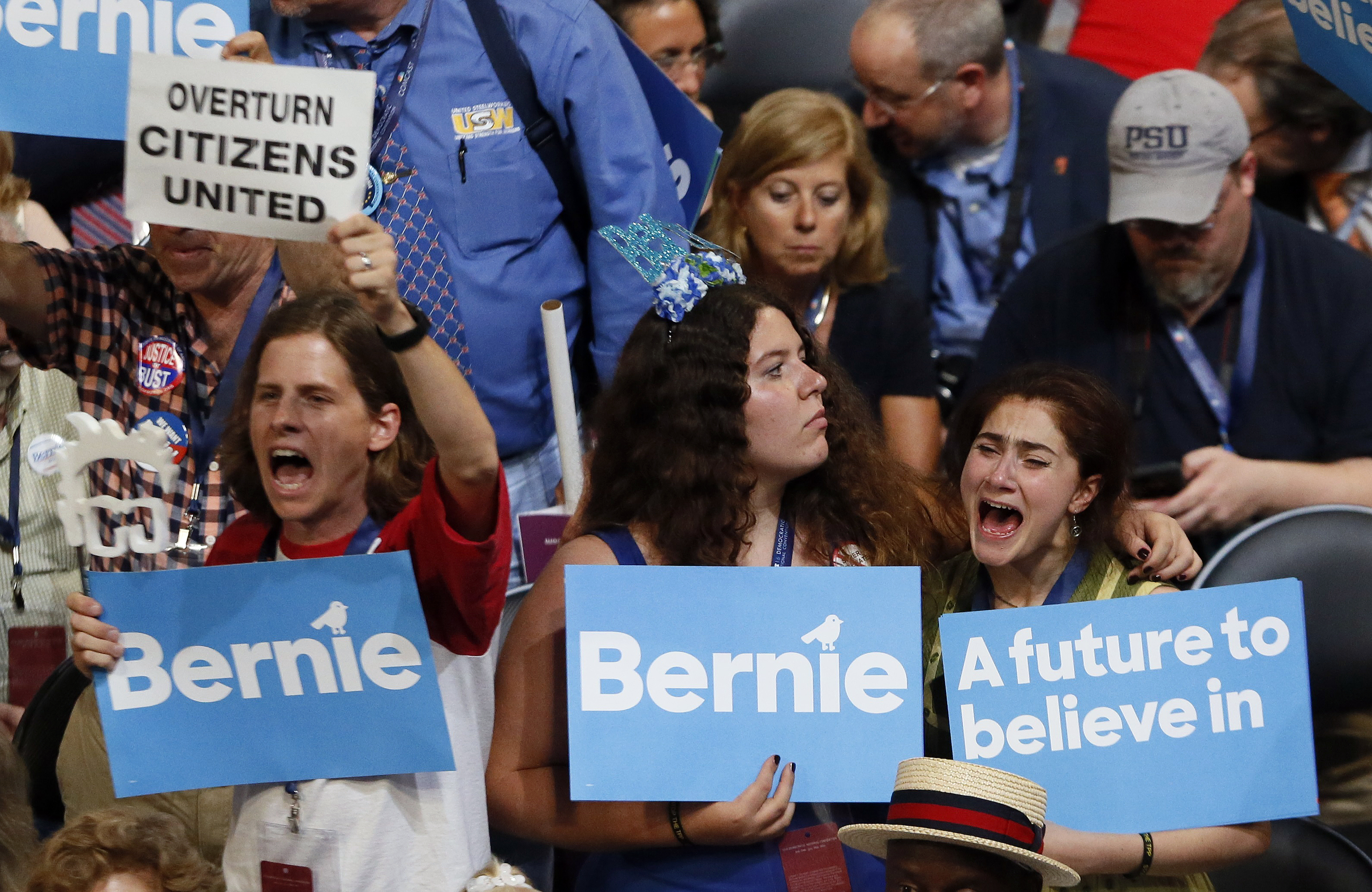 Bernie Sanders react as they listen to him speak during the Democratic National Convention in Philadelphia