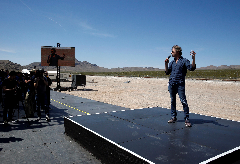 Hyperloop One co-founder Brogan BamBrogan speaks following a propulsion open-air test at Hyperloop One in North Las Vegas
