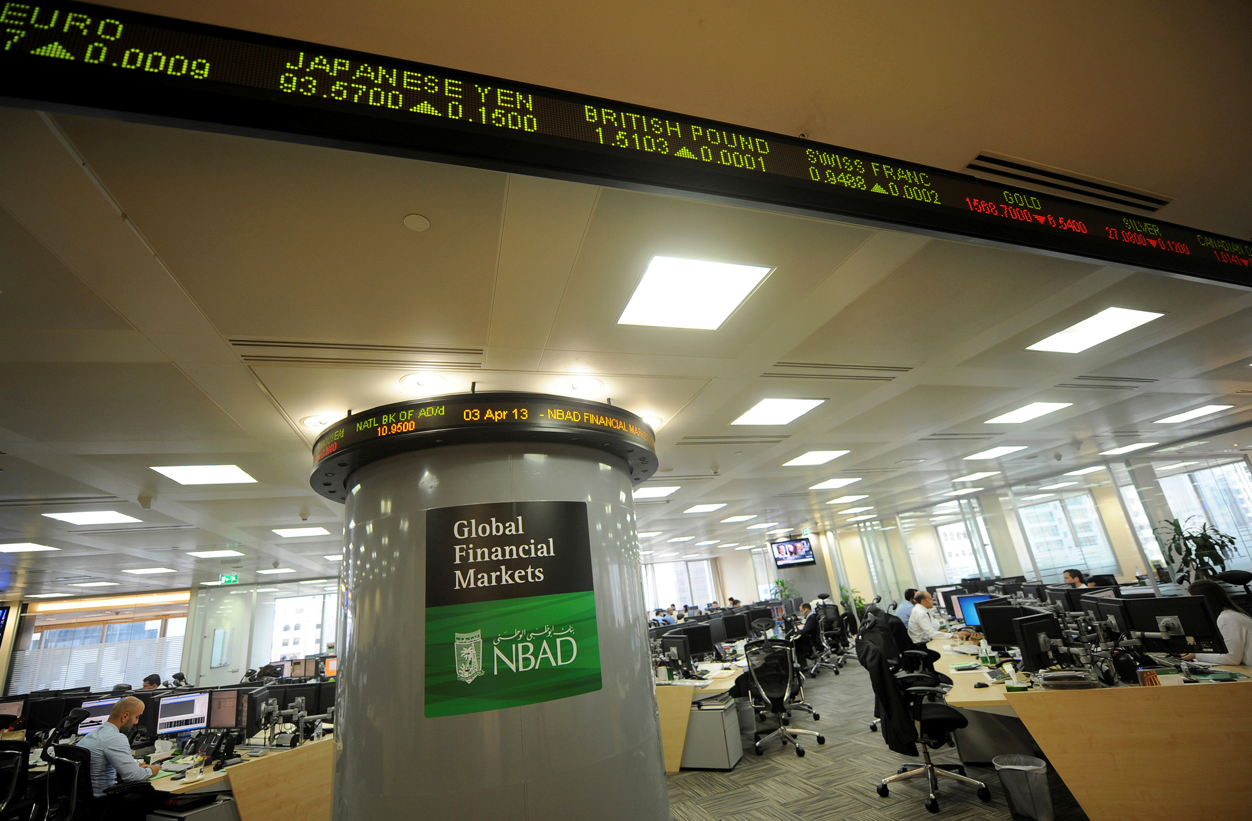 Employees are seen in the offices at the National Bank of Abu Dhabi headquarters