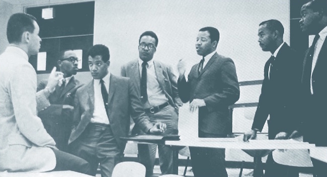 Six of IU's seven inaugural class members in a 1968 meeting with Dr. L. Richard Oliker, left, administrative director of the MBA program in 1968. Fourth from left, Vernon Mason.