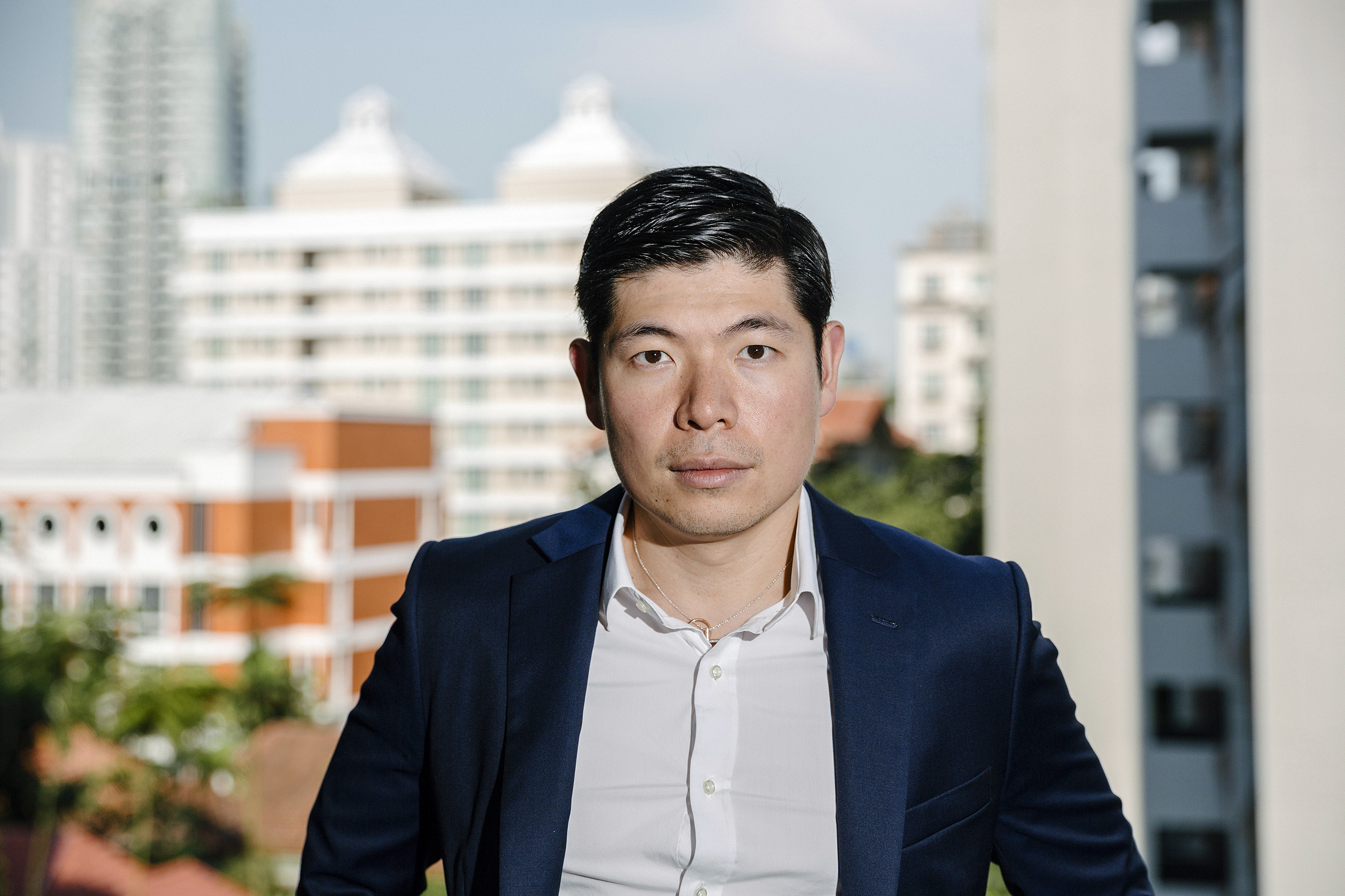 Anthony Tan, founder of GrabTaxi, stands on the balcony of his new home overlooking the cityscape of Singapore. The company is currently one of the big startup success stories of Southeast Asia. Tan founded the company in 2012 in Malaysia. Today the taxi app is available in 21 cities across the region, and has raised a total of US$340 million in funding.