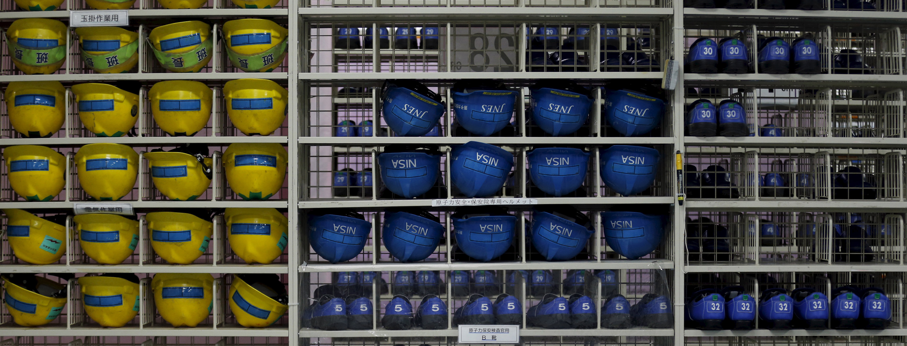 Helmets and shoes for workers who work inside reactor building are placed in shelves at no.6 reactor building at Tokyo Electric Power Co.'s Kashiwazaki Kariwa nuclear power plant