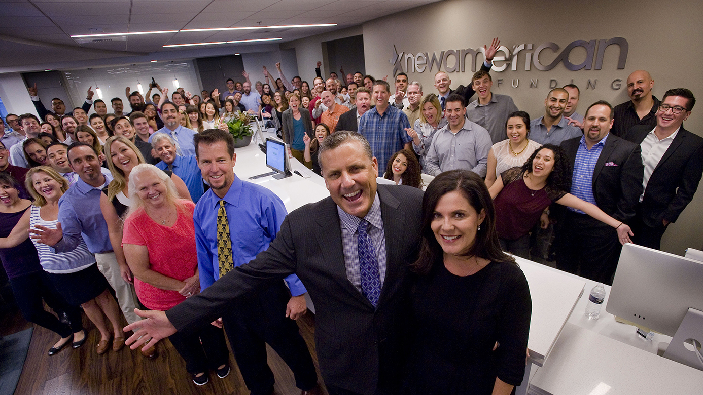 Rick and Patty Arvielo, center foreground, with employees of their company New American Funding in Tustin. ///ADDITIONAL INFO: twp.newamericanfunding.1203 - 10/21/15 - Photo by PAUL RODRIGUEZ, STAFF PHOTOGRAPHER - Rick and Patty Arvielo with employees of their company New American Funding in Tustin.