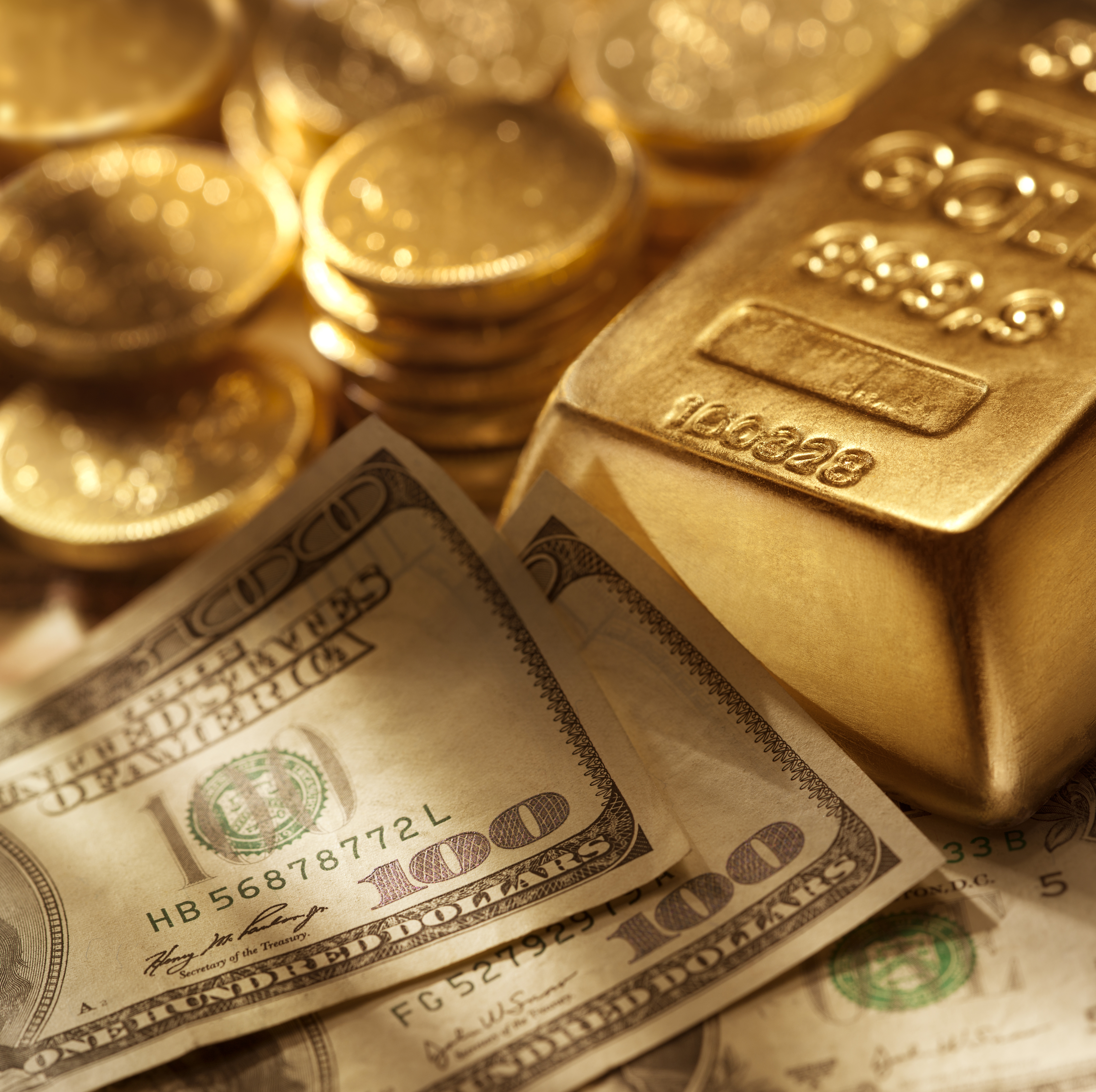 Hundred dollar bills surrounded by gold