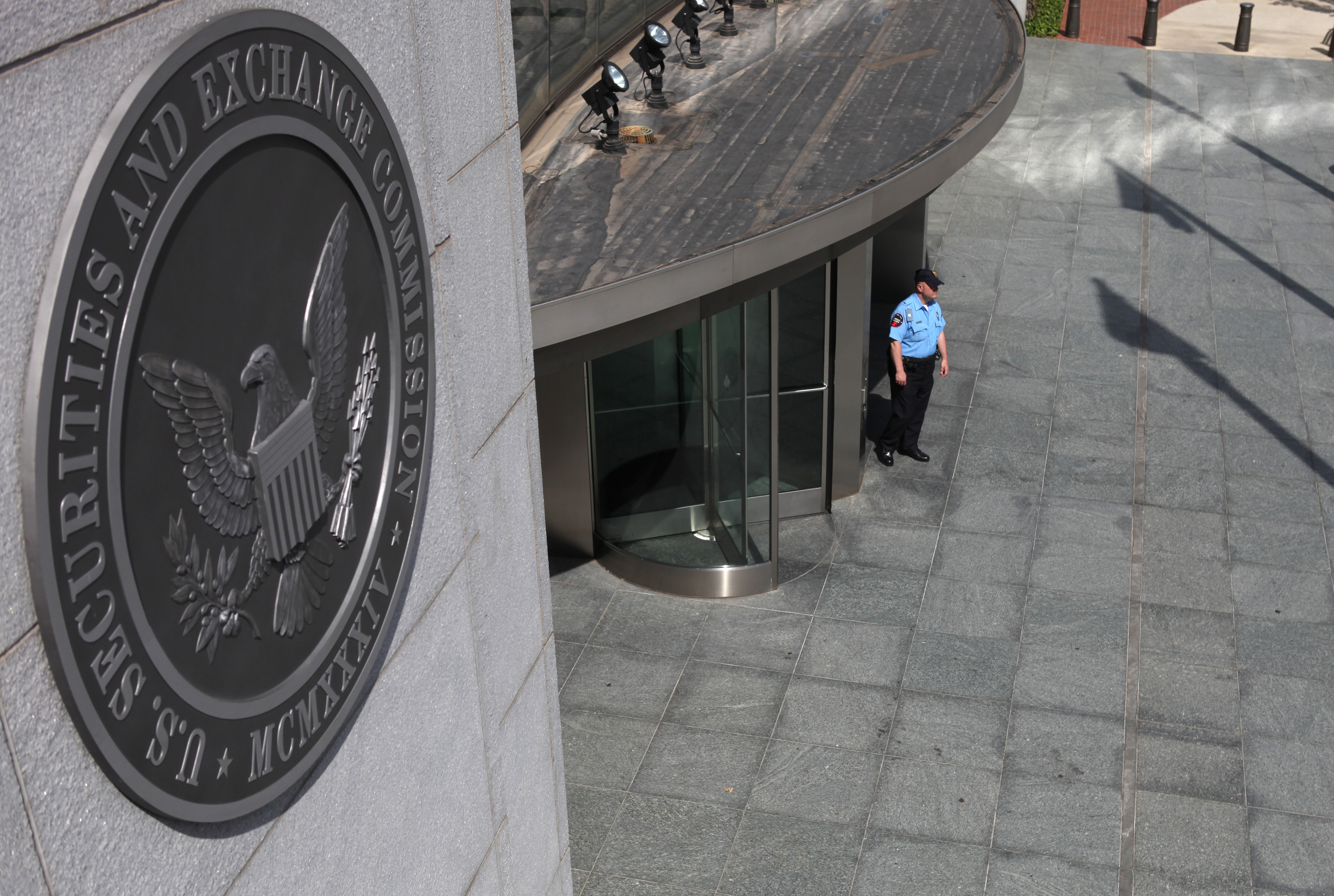 A security officer stands outside the U.S. Securities and Exchange Commission headquarters