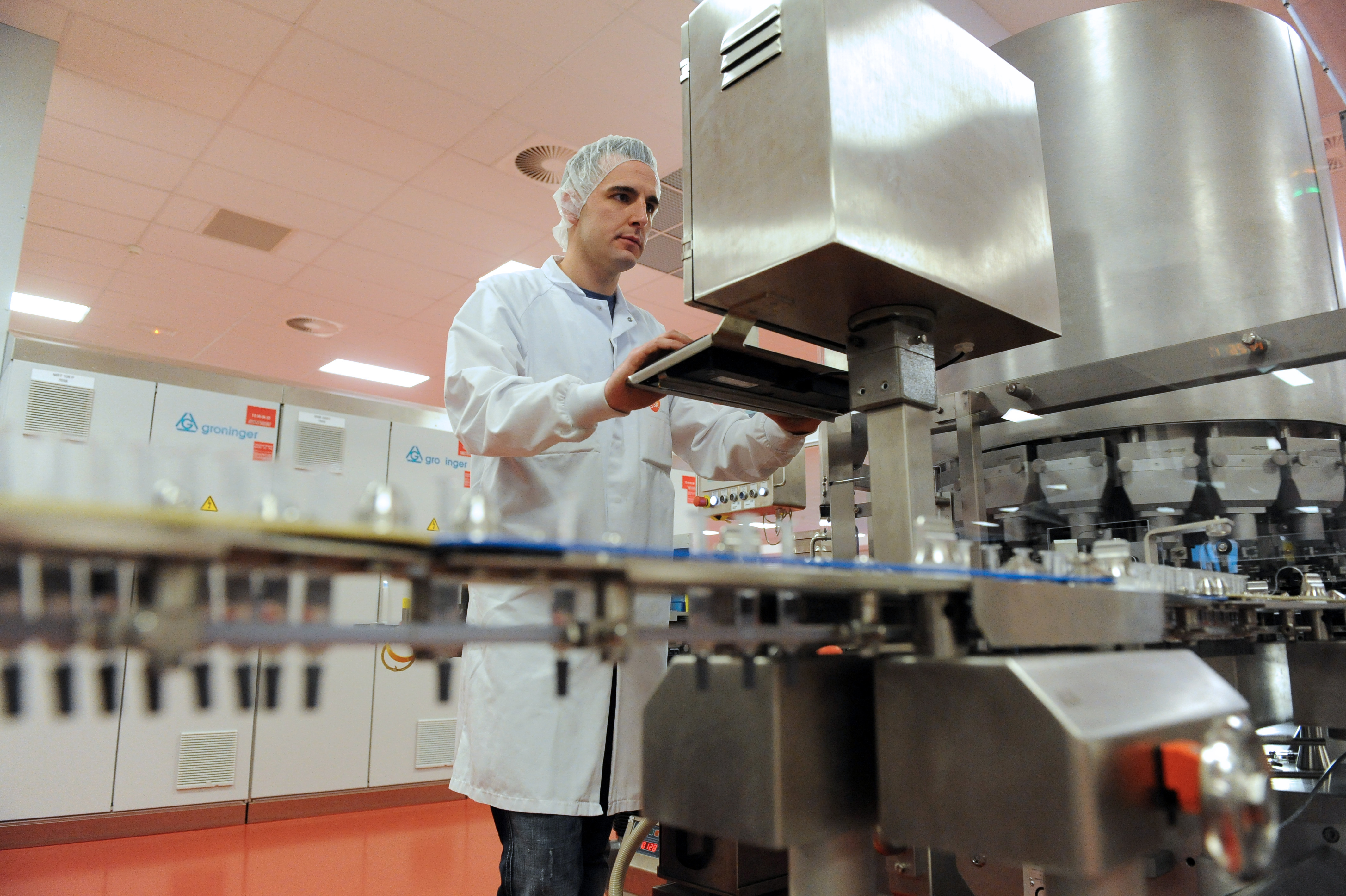 A man is at work at a vaccine production