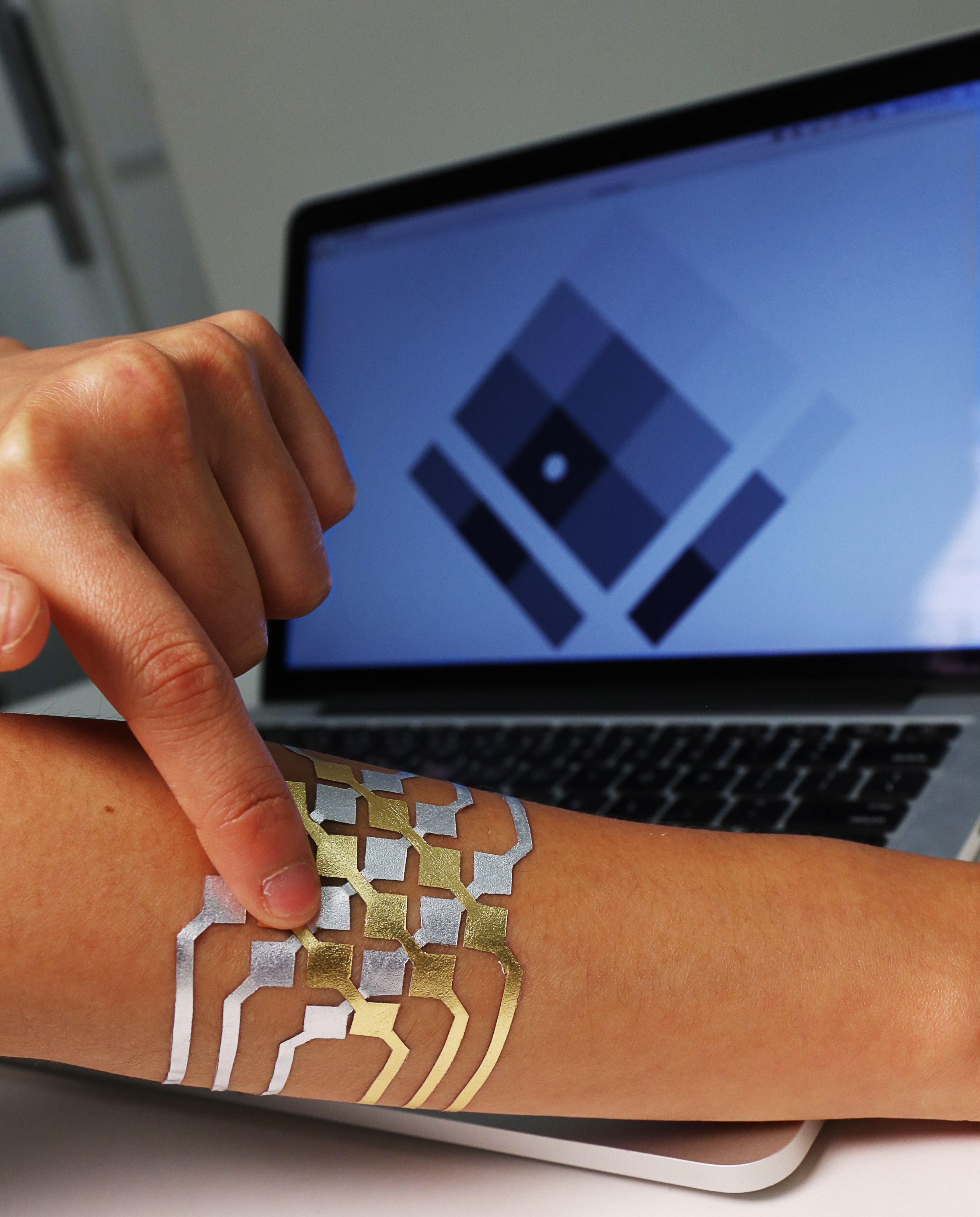 DuoSkin in action, controlling the pixels on screen.