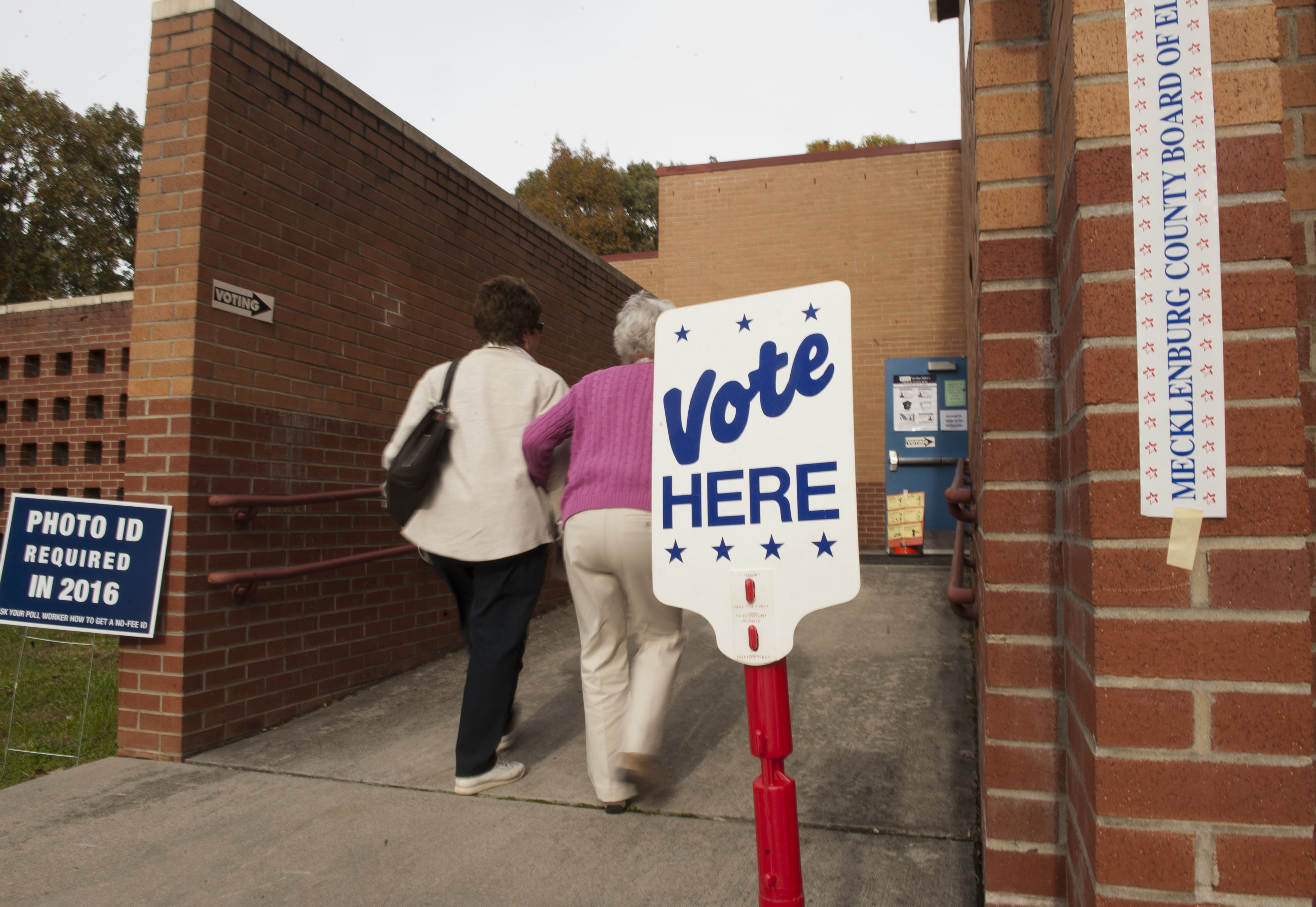 People enter Cotswold School to vote in Charlotte, North Carolina.