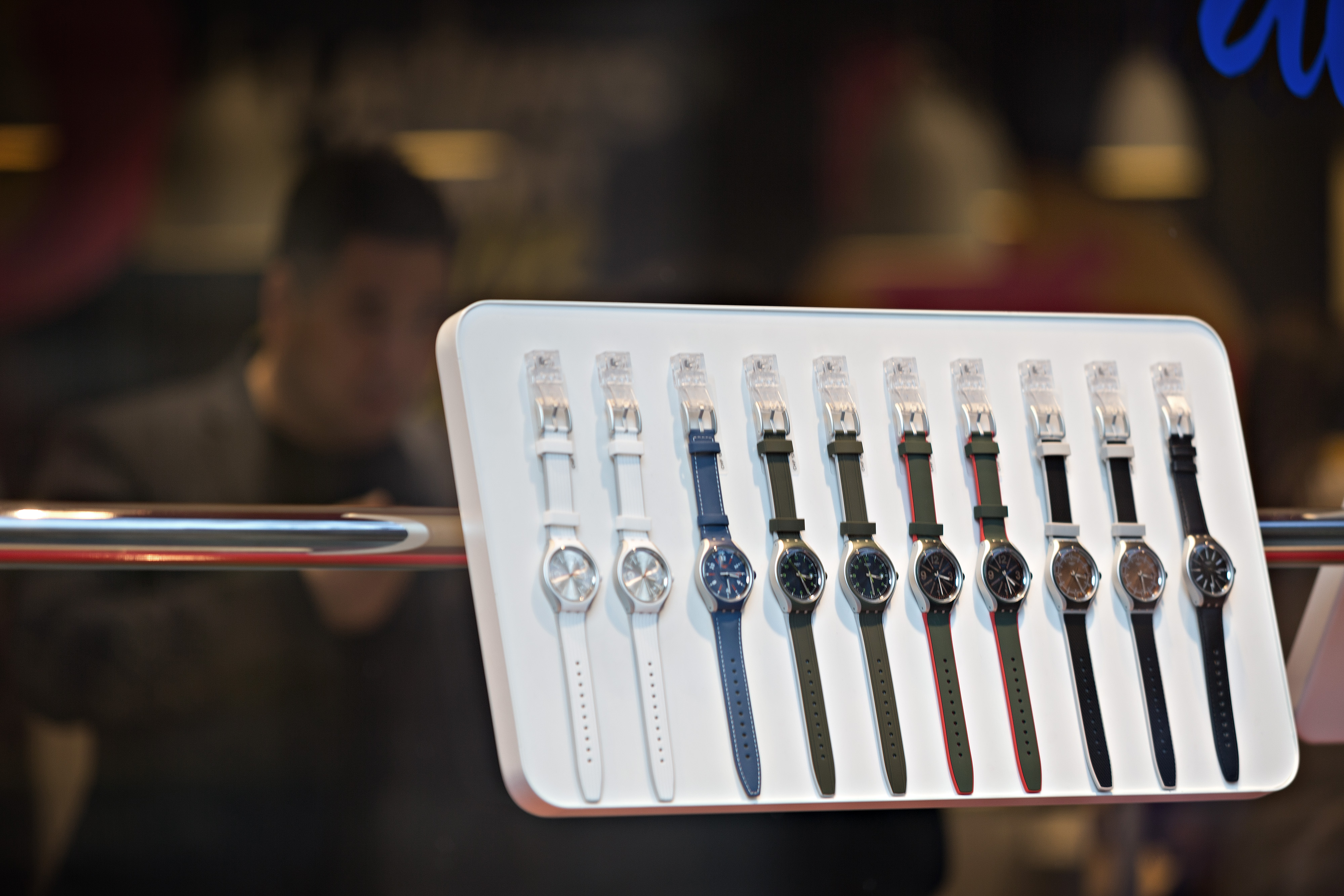 Wrist watches sit on display in the window of a Swatch store in Zurich