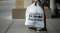 A woman carries a Bed, Bath and Beyond shopping bag as she exits a store in Albuquerque.