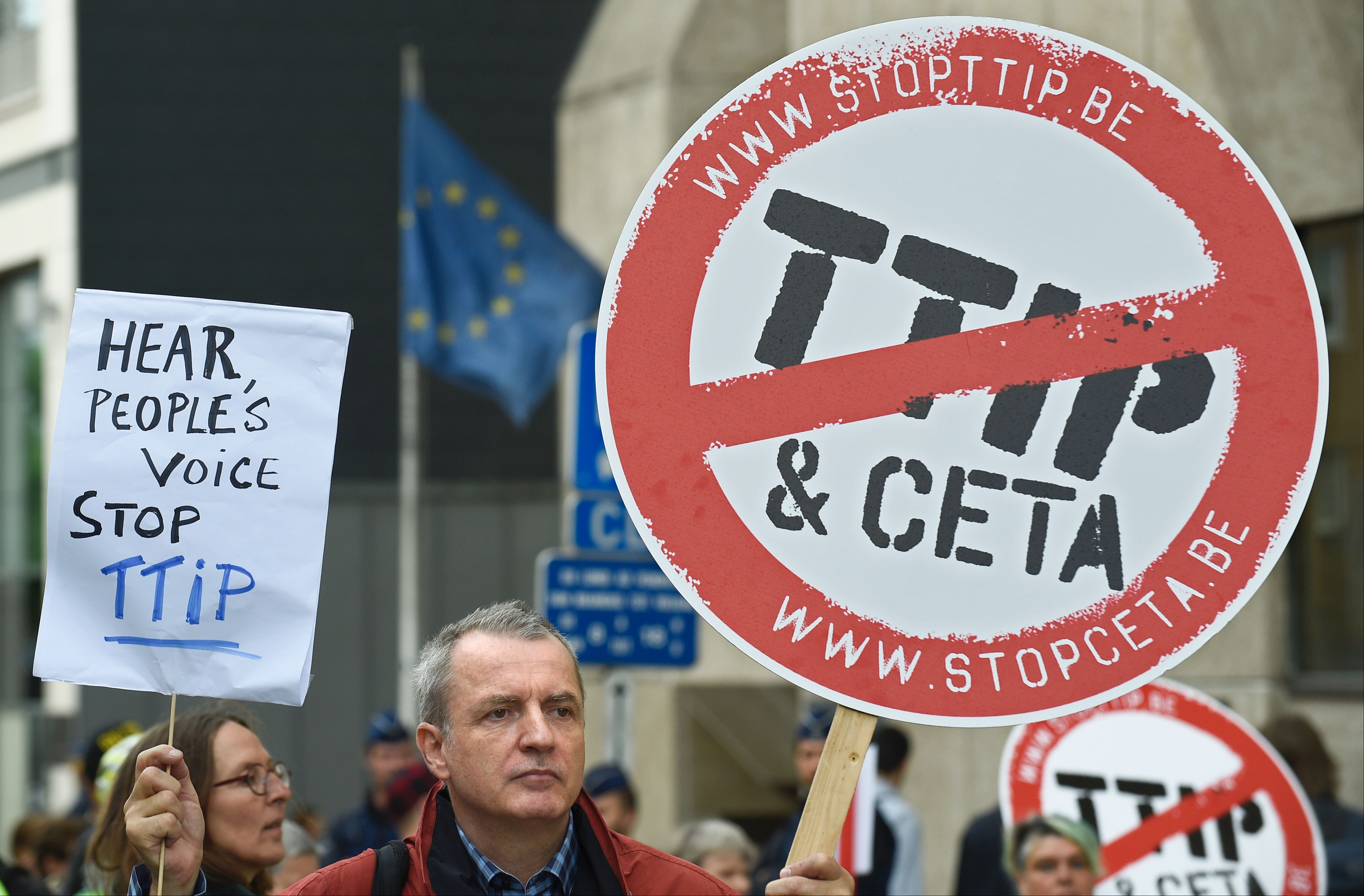 Activists hold banners during a protest against the Transatlantic Trade and Investment Partnership (TTIP) in front of the EU commission building in Brussels.