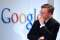 Eric Schmidt, chief executive officer of Google Inc., listen