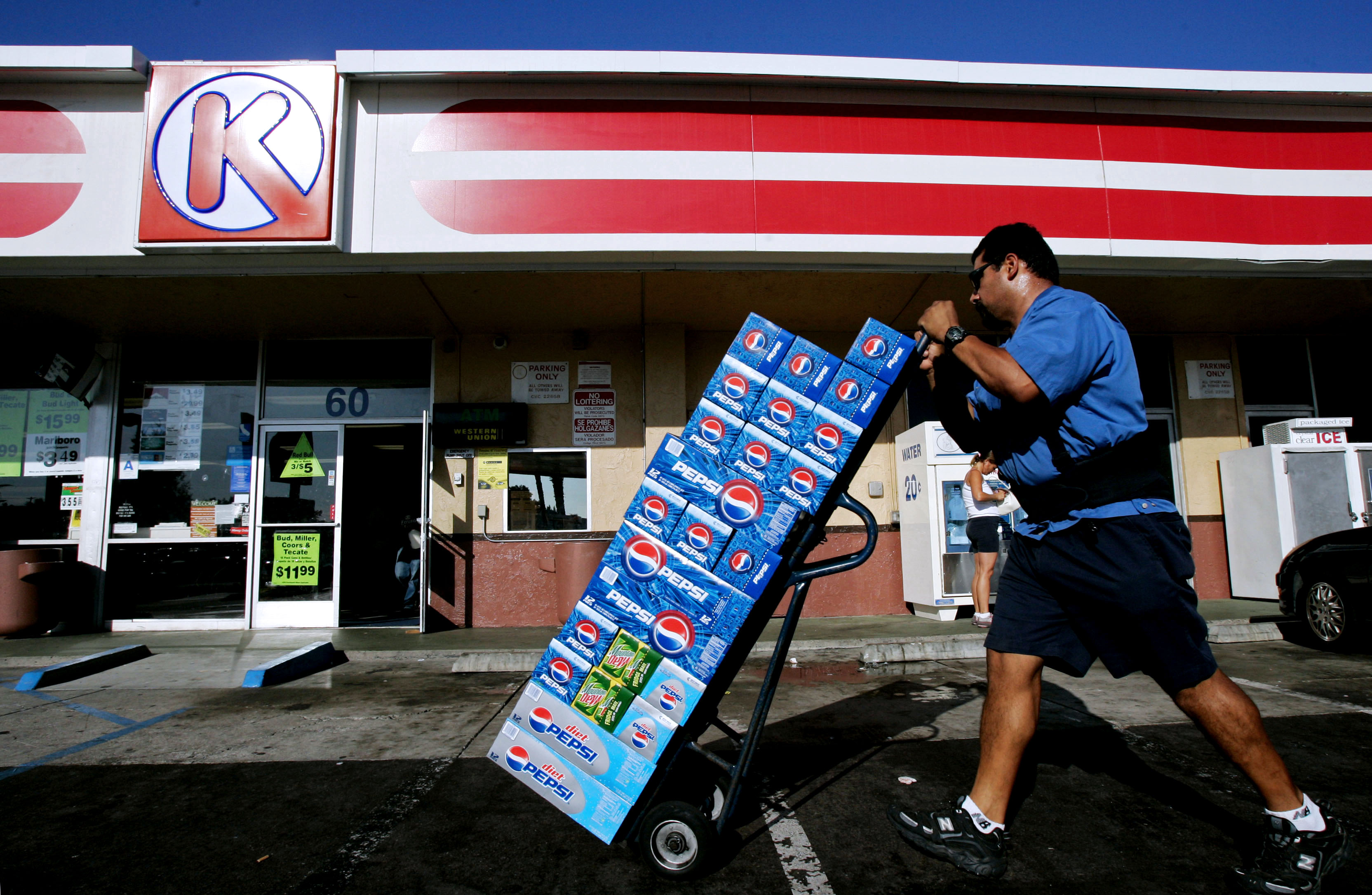 A vendor carts Pepsi products into a Circle K store in Chula