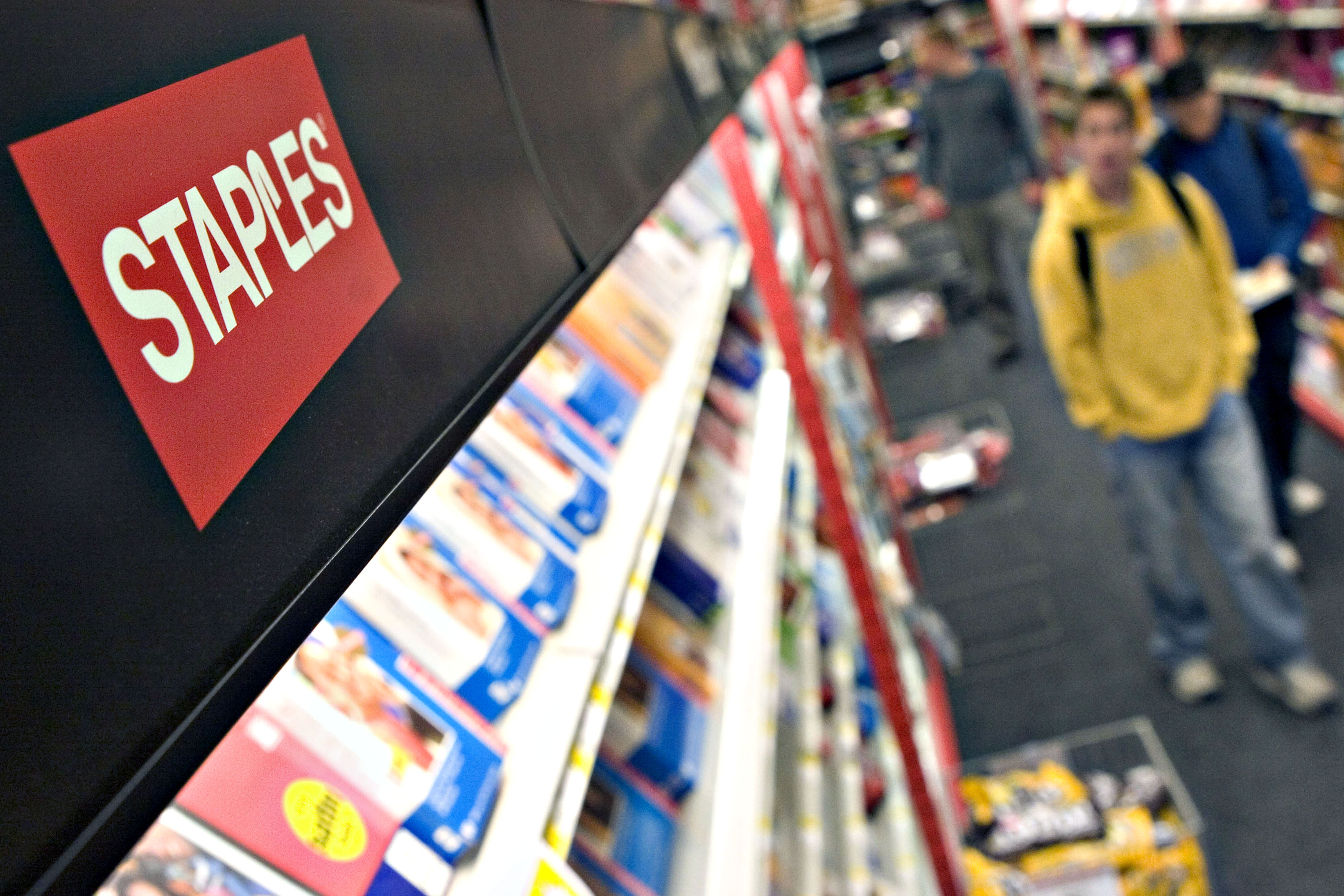 Customers shop inside a Staple's store in Allston, Massachus