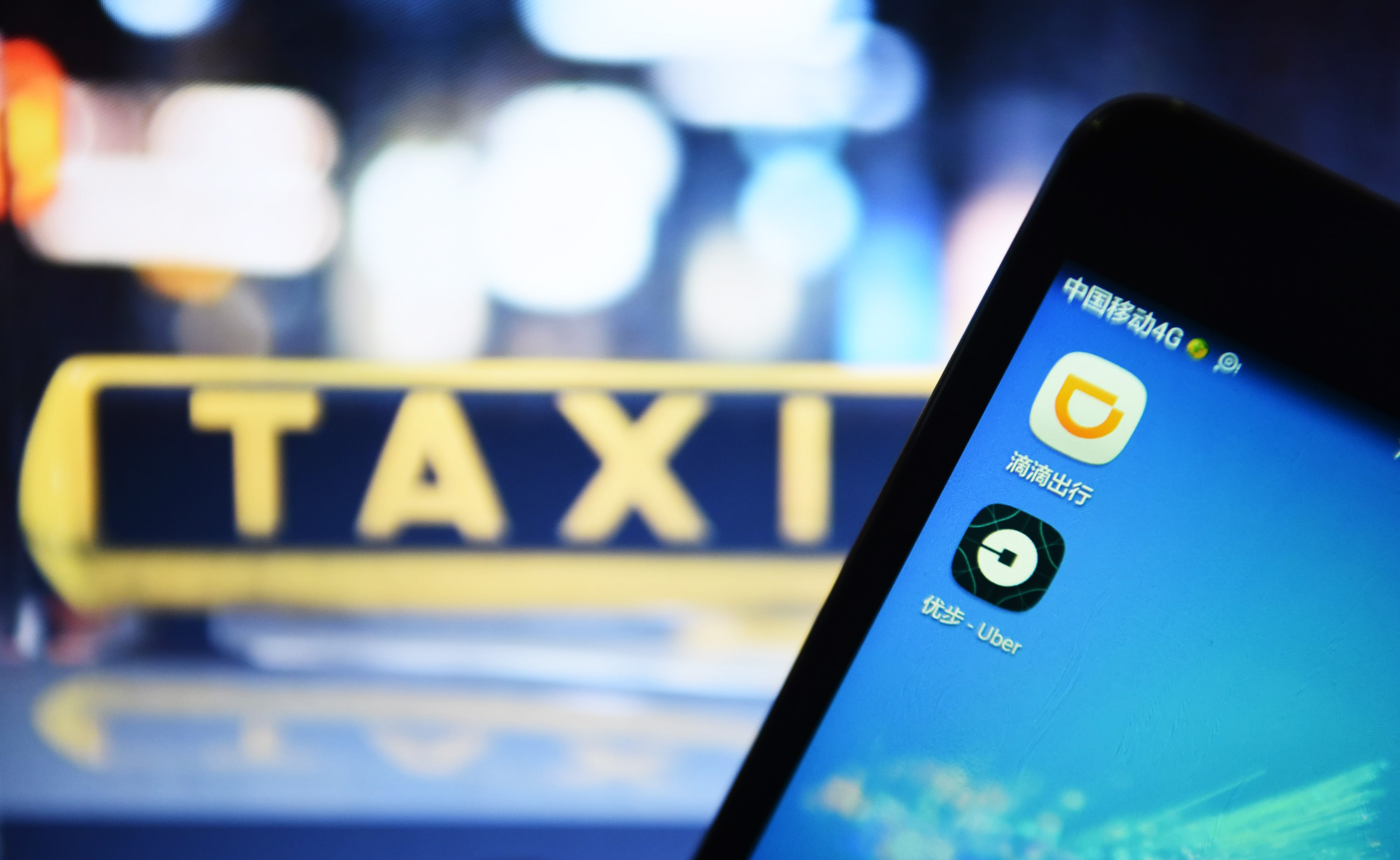 China regulator says Didi, Uber deal will need Mofcom approval